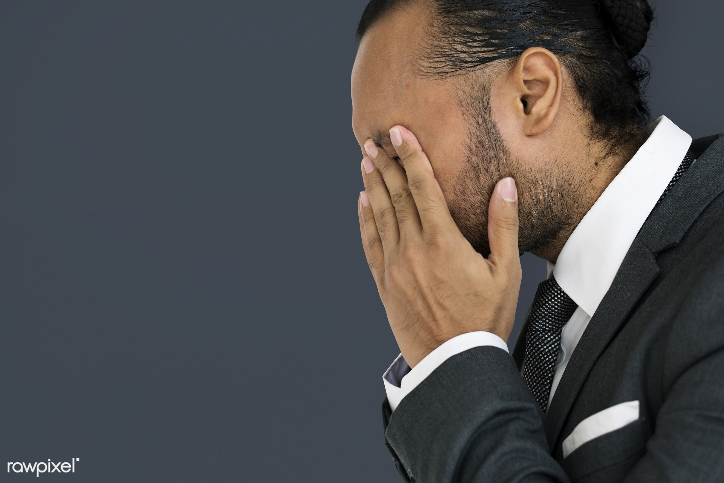 Stressed man rubbing his eyes - adult, background, business, closed, disappointed, ethnicity, expression, face, female,...