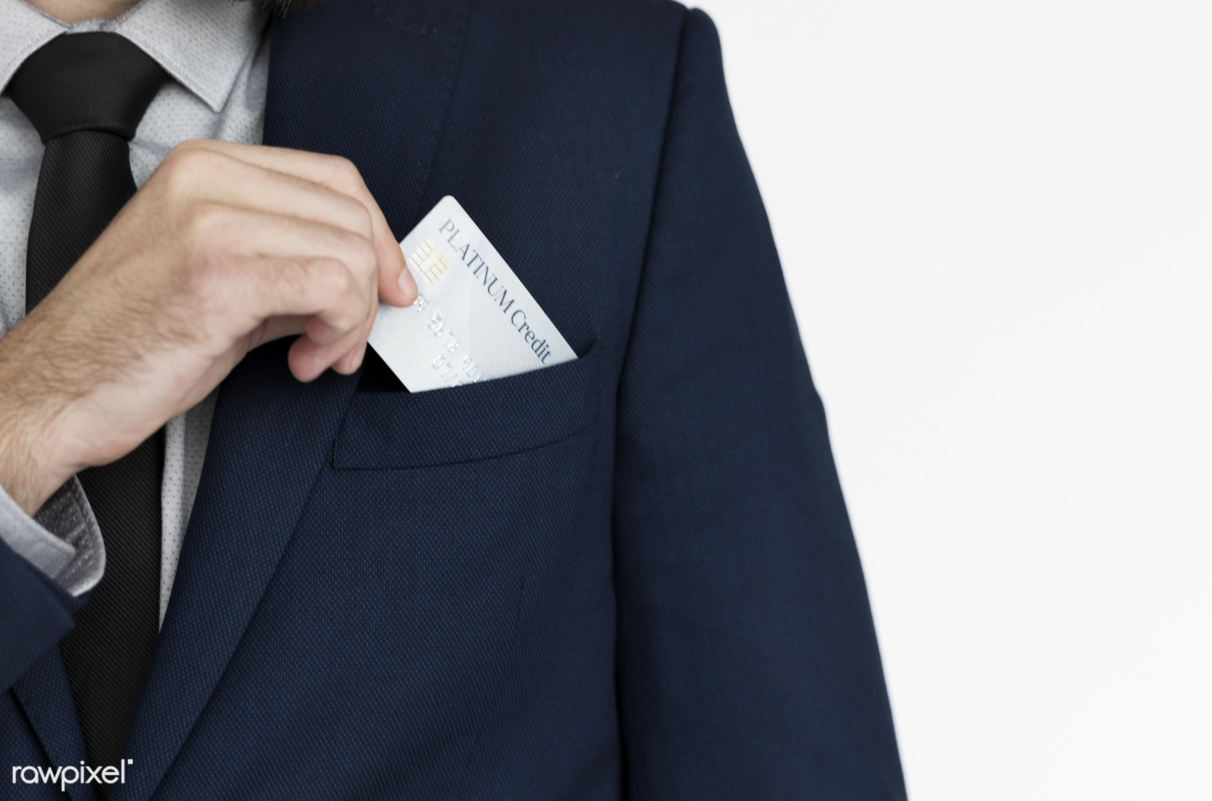 Businessman putting a business card into his pocket - studio, person, one, people, business, modern, businessman, style,...