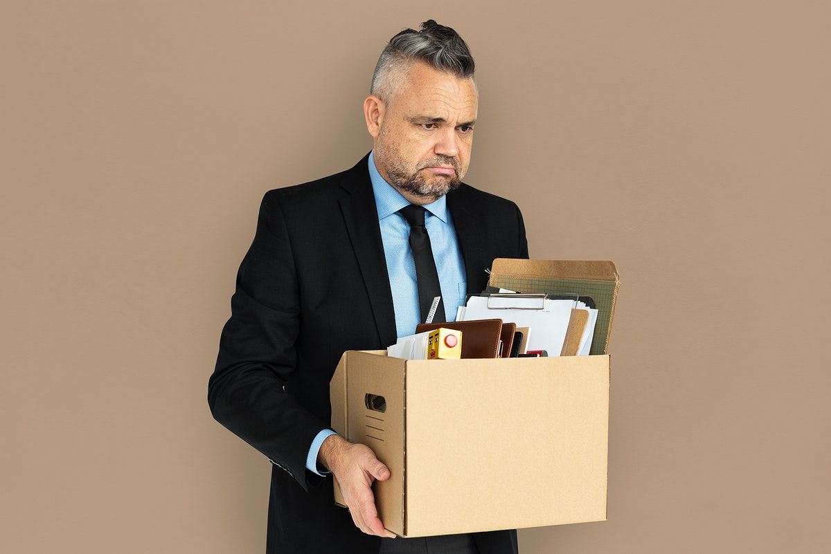 Caucasian Man Holding Box Sad