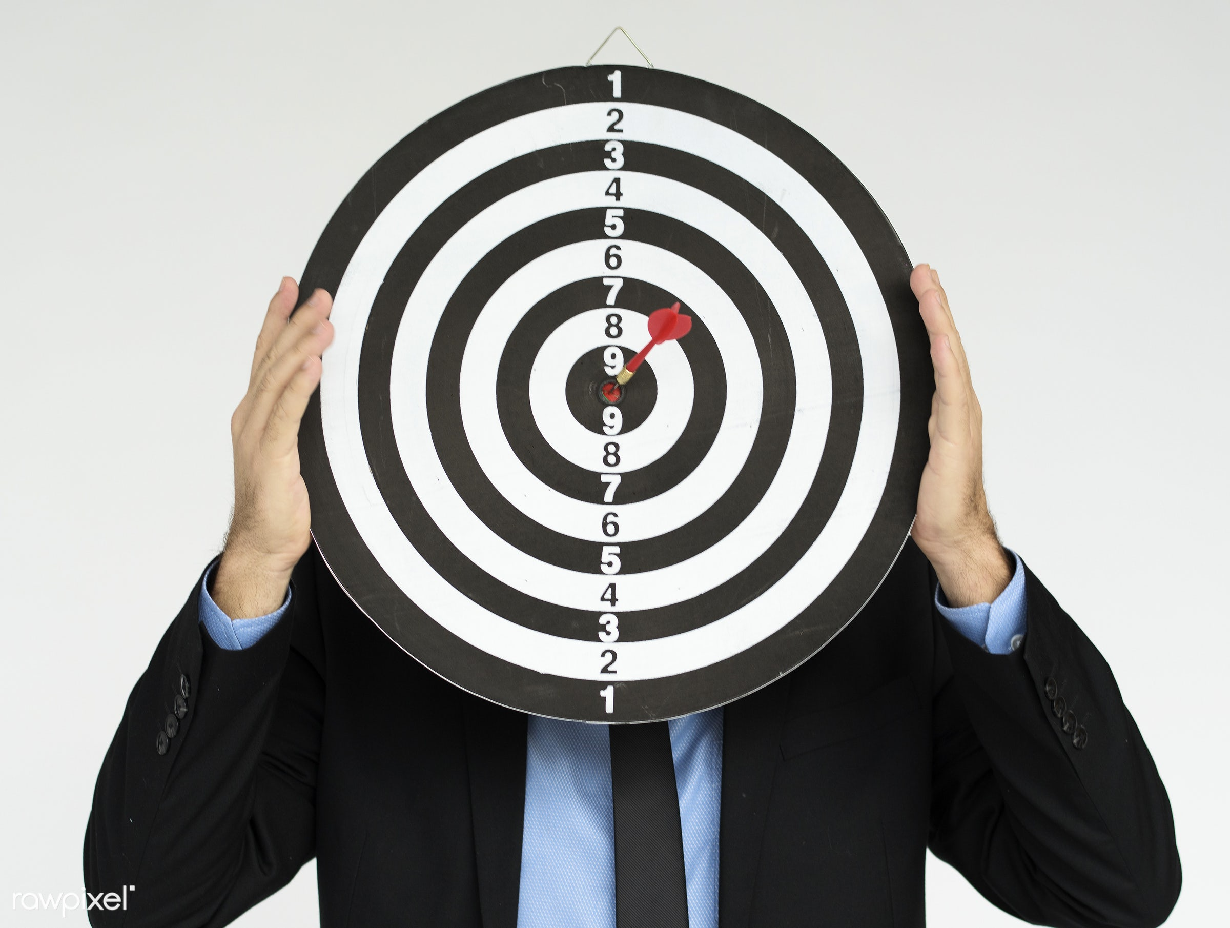 Businessman holding a dartboard - studio, person, one, people, business, modern, businessman, style, attractive, positive,...