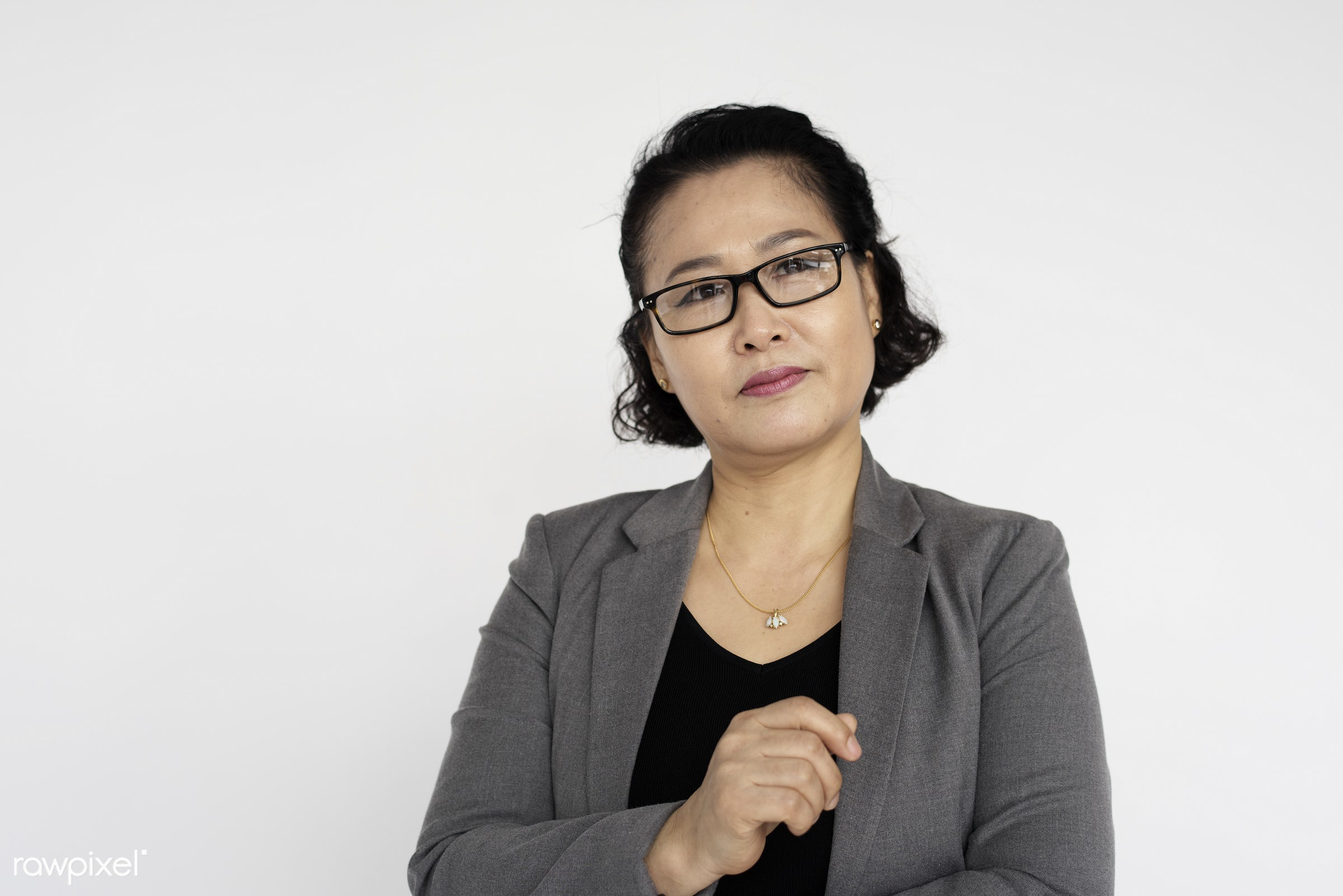Portrait of a mature Asian businesswoman - expression, studio, person, glasses, isolated on white, one, people, business,...