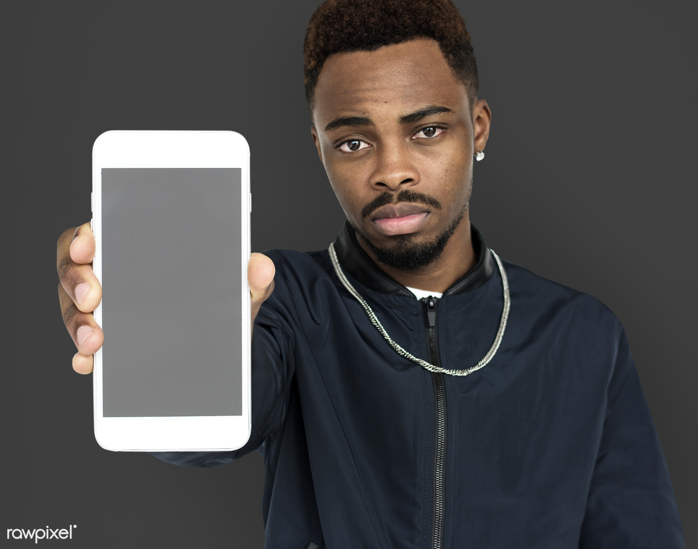 african descent, background, beard, black, communication, device, emotion, expression, focused, grey, holding, holding phone...