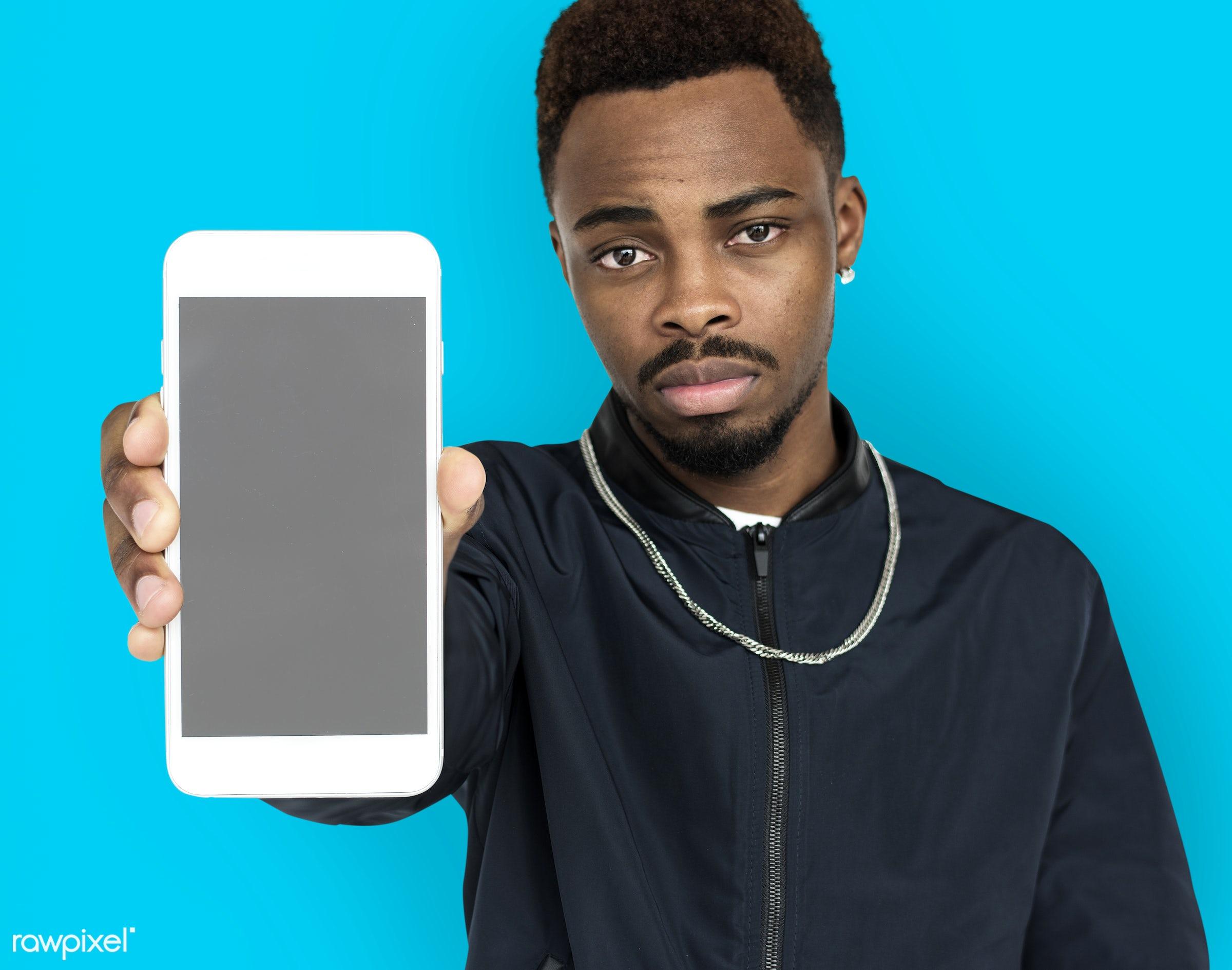 african descent, background, beard, black, blue, communication, device, emotion, expression, focused, holding, holding phone...