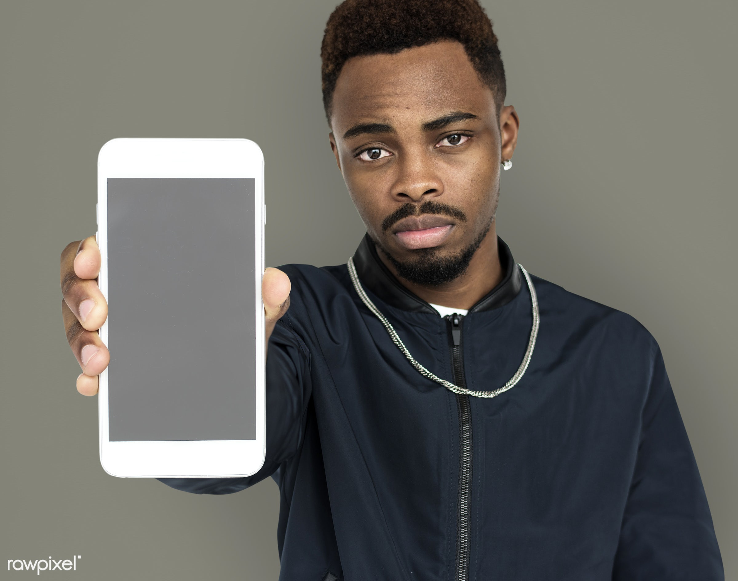african descent, background, beard, black, communication, device, emotion, expression, focused, holding, holding phone,...