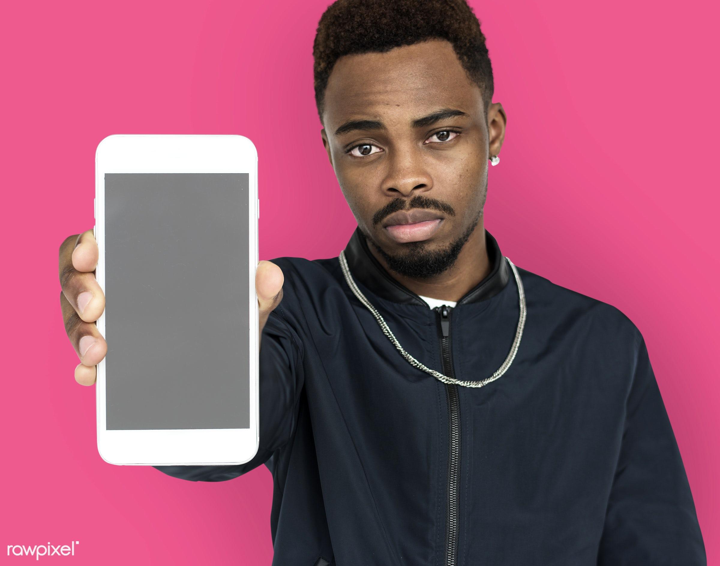 african descent, background, beard, black, communication, device, emotion, expression, focused, holding, holding phone,...