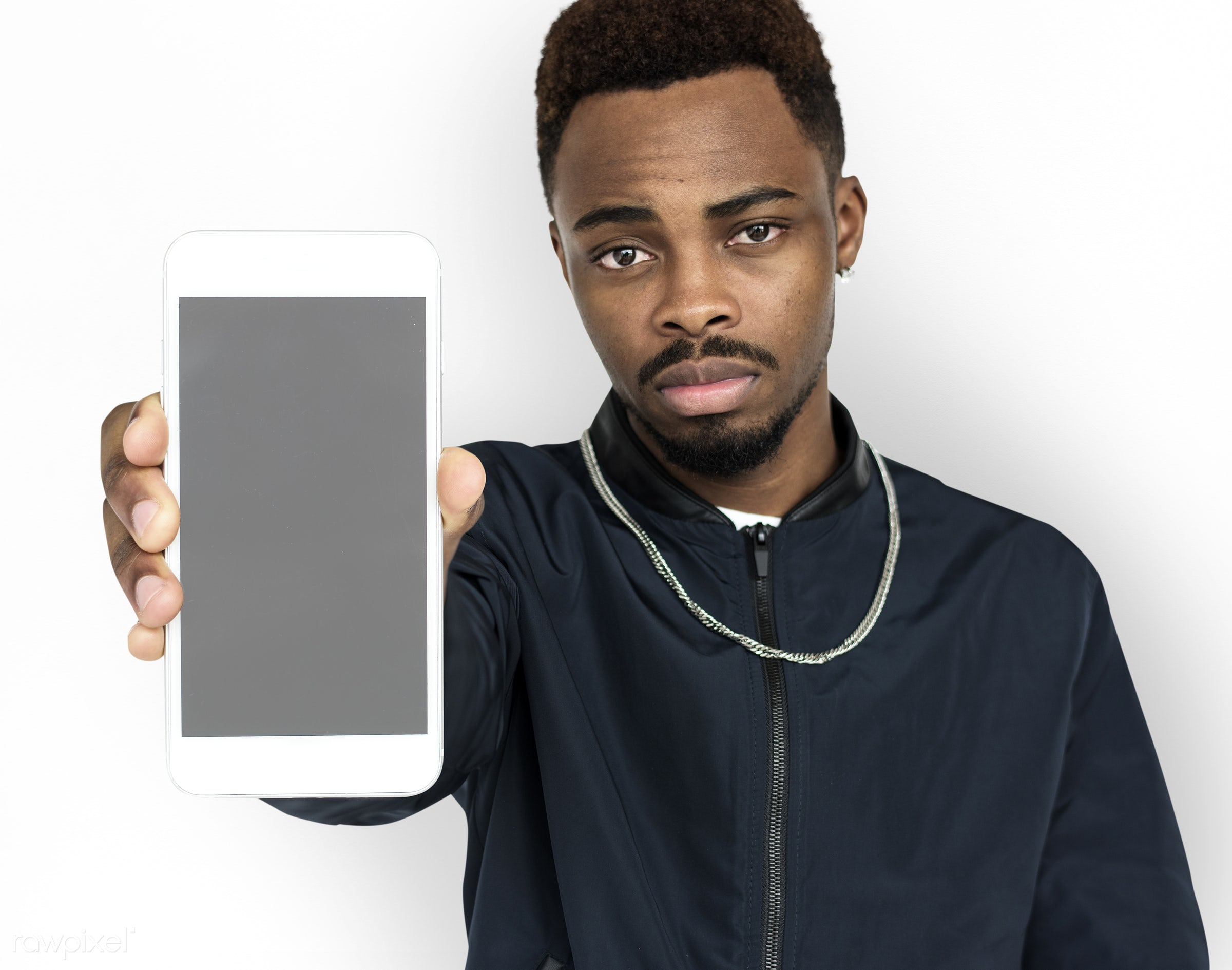studio, expression, phone, person, technology, portable, poker face, holding, people, mobile phone, focused, serious, black...