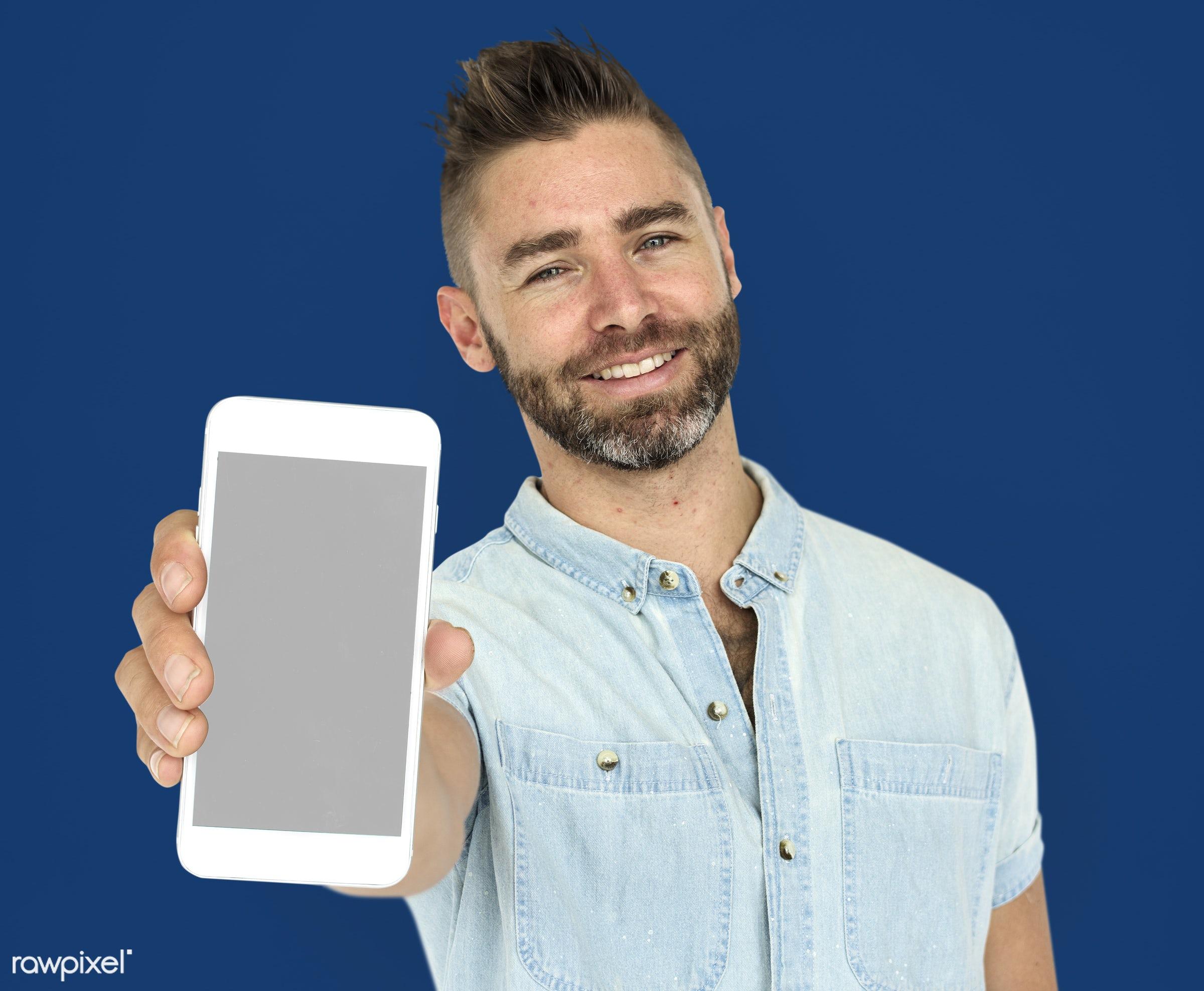 background, beard, blue, caucasian, communication, device, emotion, expression, holding, holding phone, isolated, male, man...