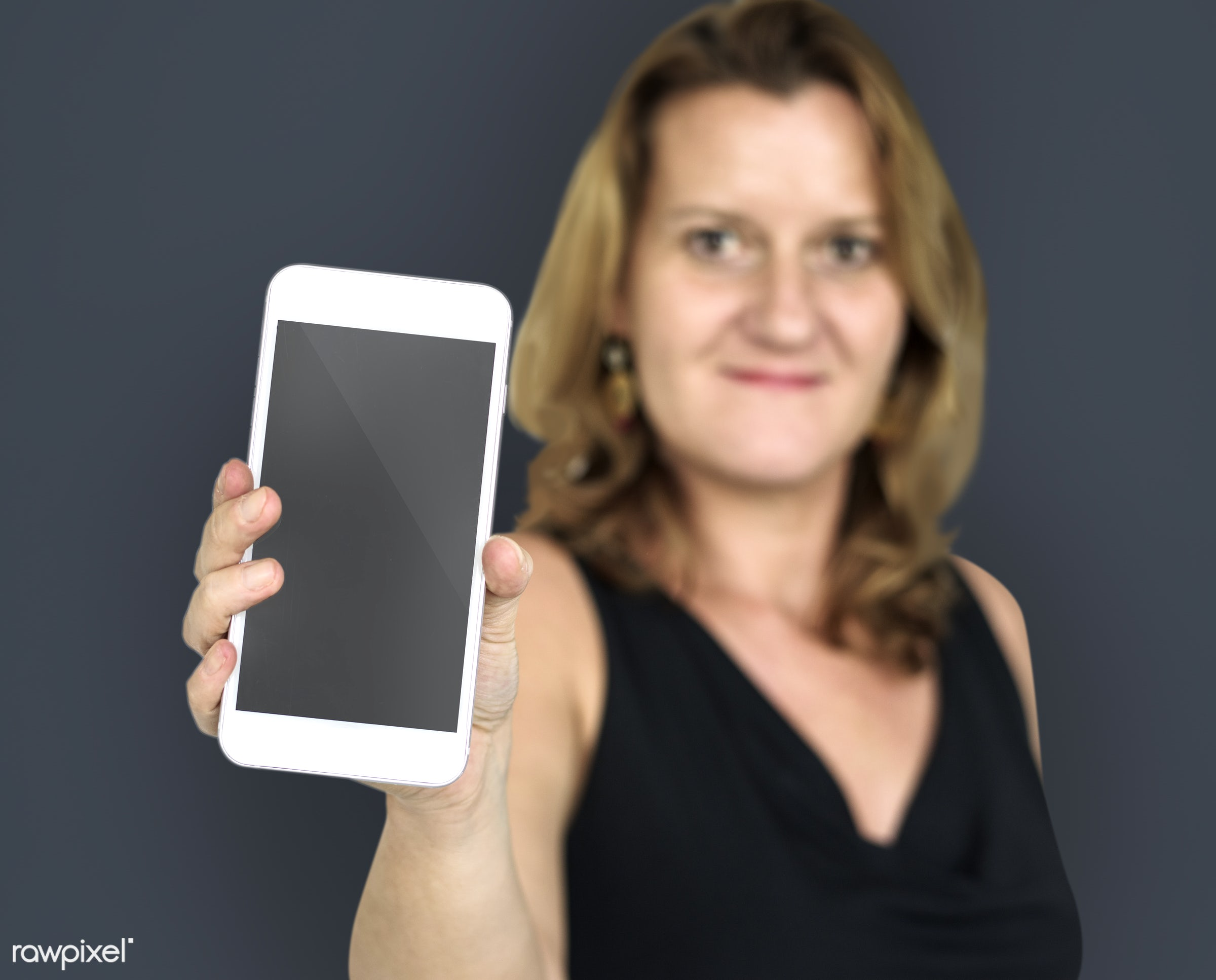 expression, studio, person, phone, portable, technology, holding, object, people, network, positivity, caucasian, girl,...