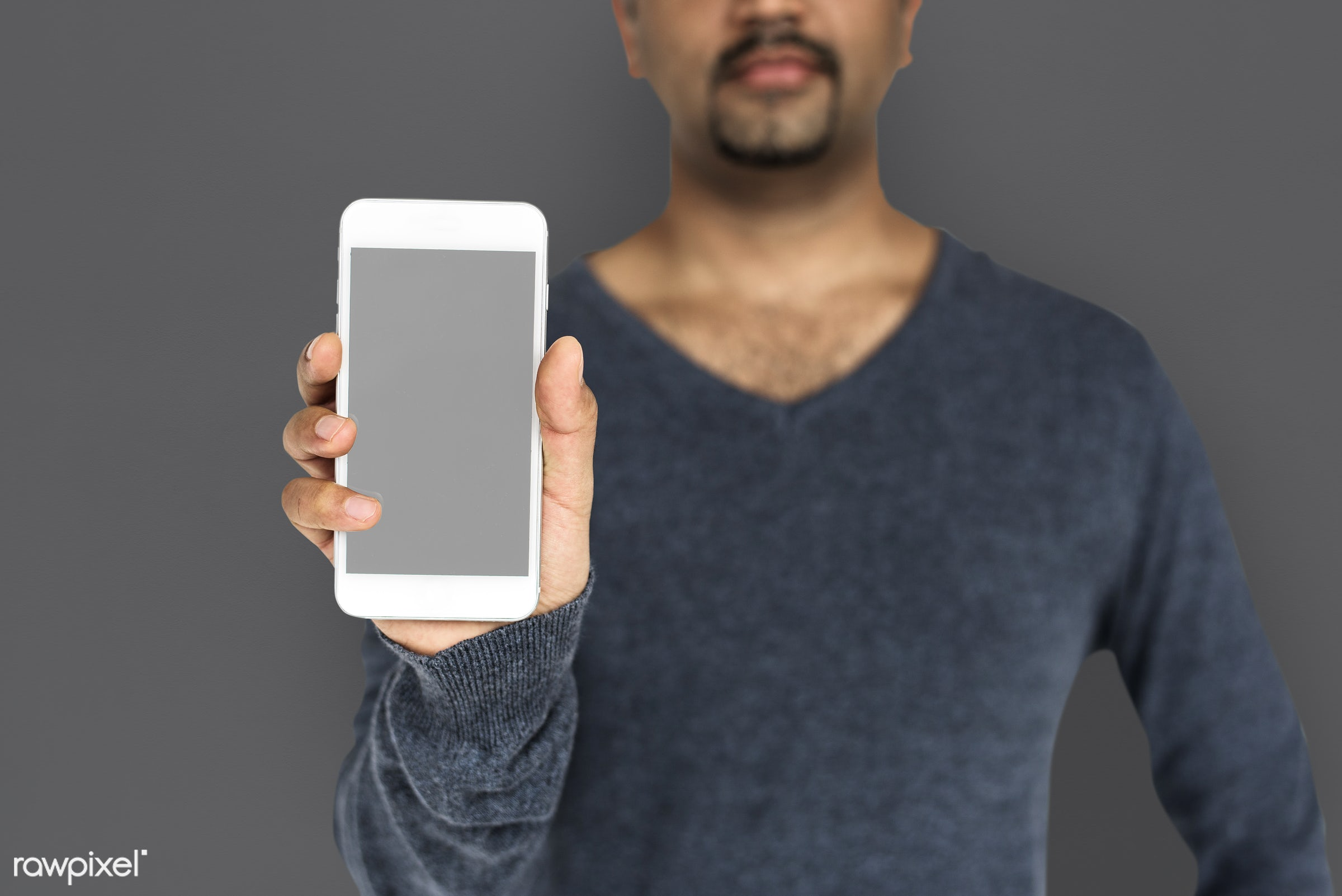 studio, expression, phone, person, technology, portable, poker face, holding, object, people, network, focused, mobile phone...