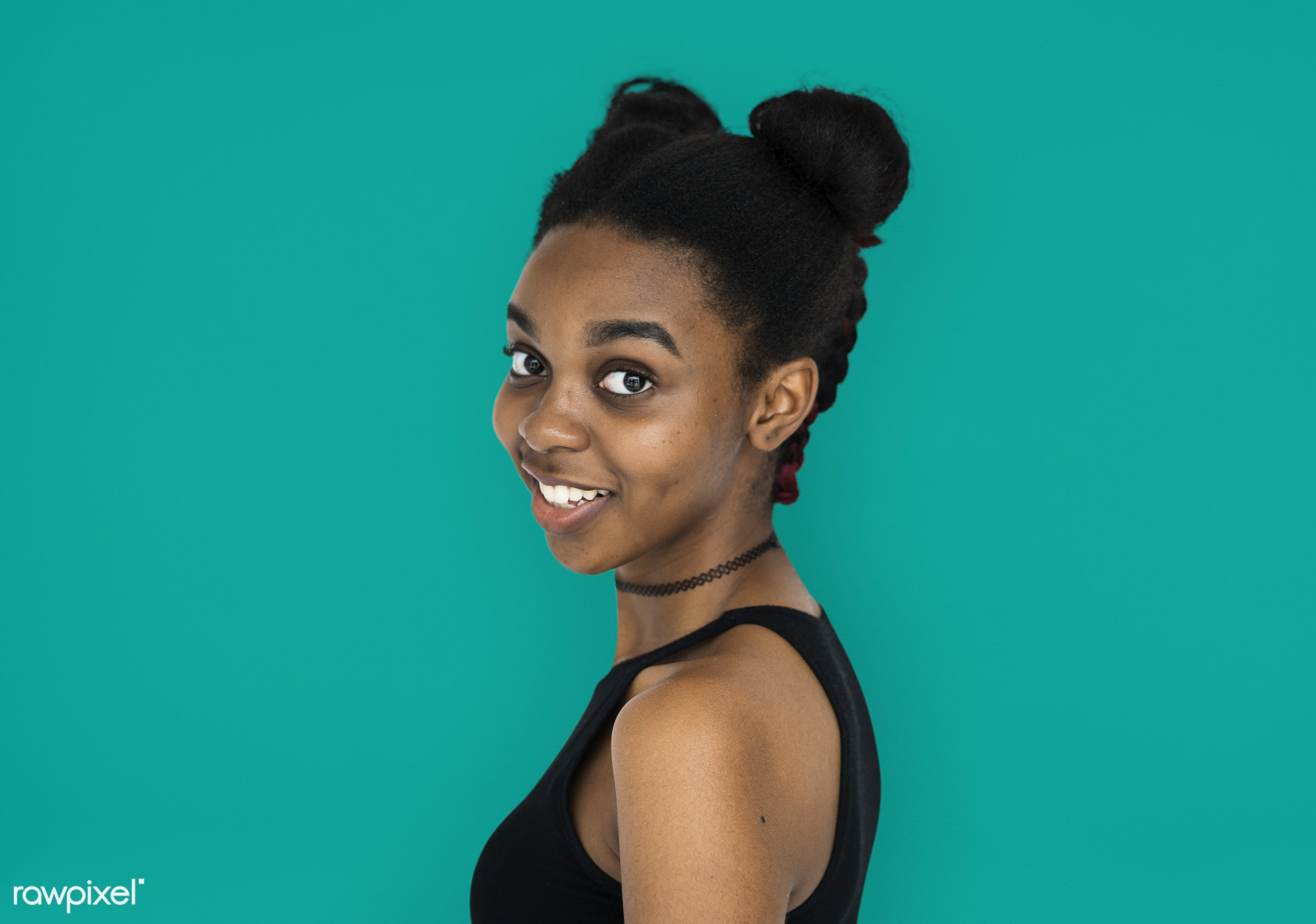 expression, studio, person, people, woman, smile, cheerful, smiling, isolated, buns, african descent, happiness, portrait,...