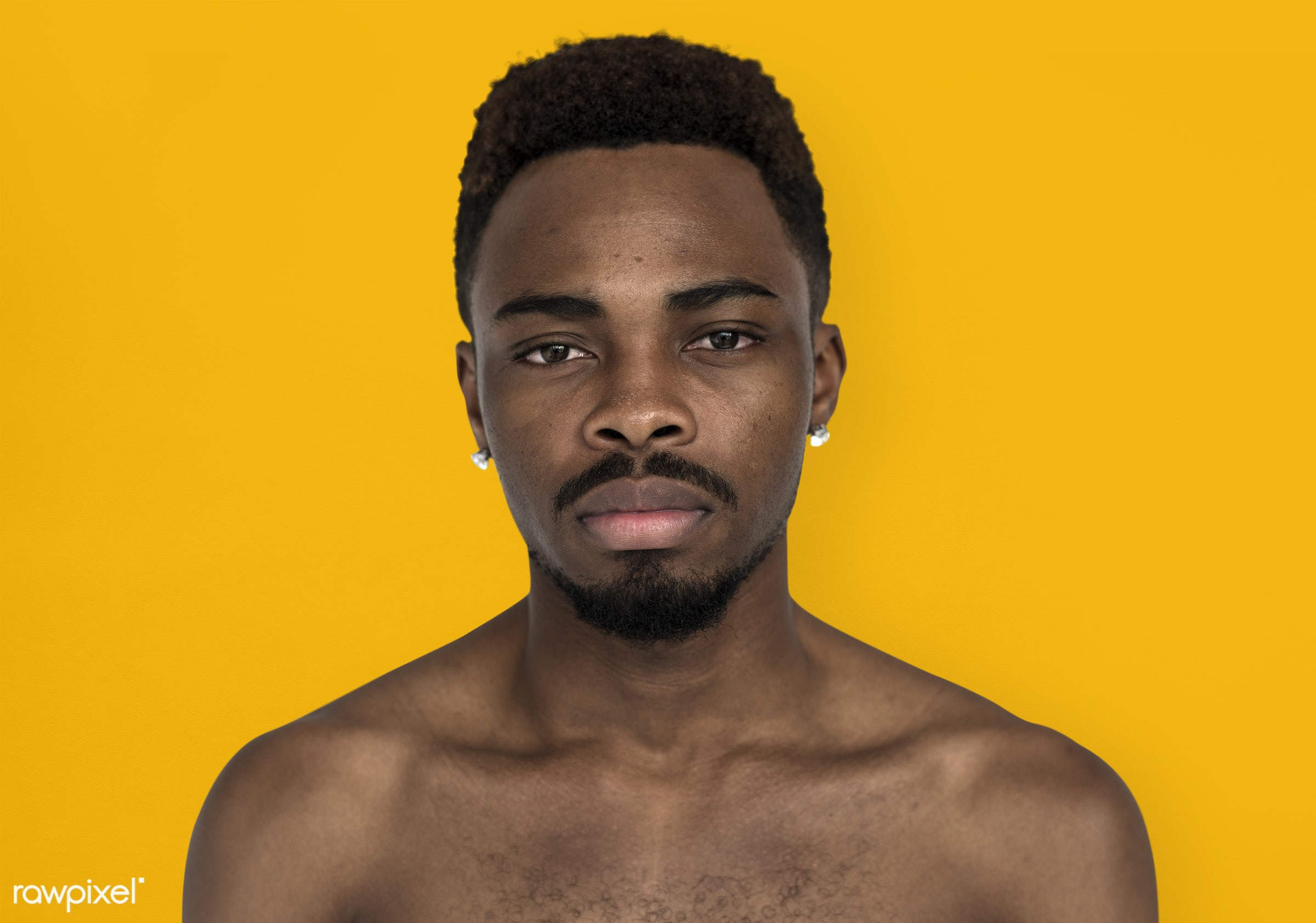 studio, face, person, yellow, people, bare chest, solo, cold, serious, man, black, earrings, isolated, orange, topless, guy...
