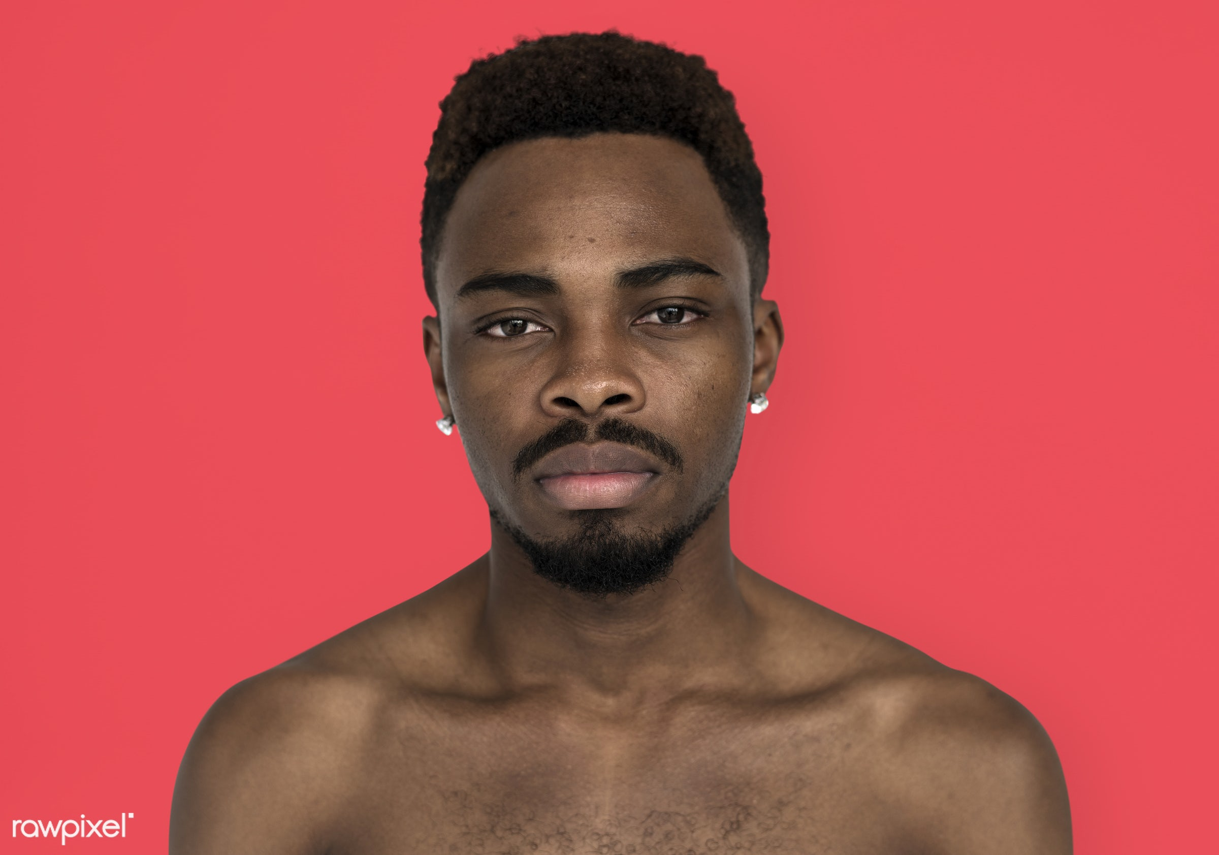 studio, face, person, people, bare chest, solo, cold, serious, man, black, earrings, isolated, orange, topless, guy, african...