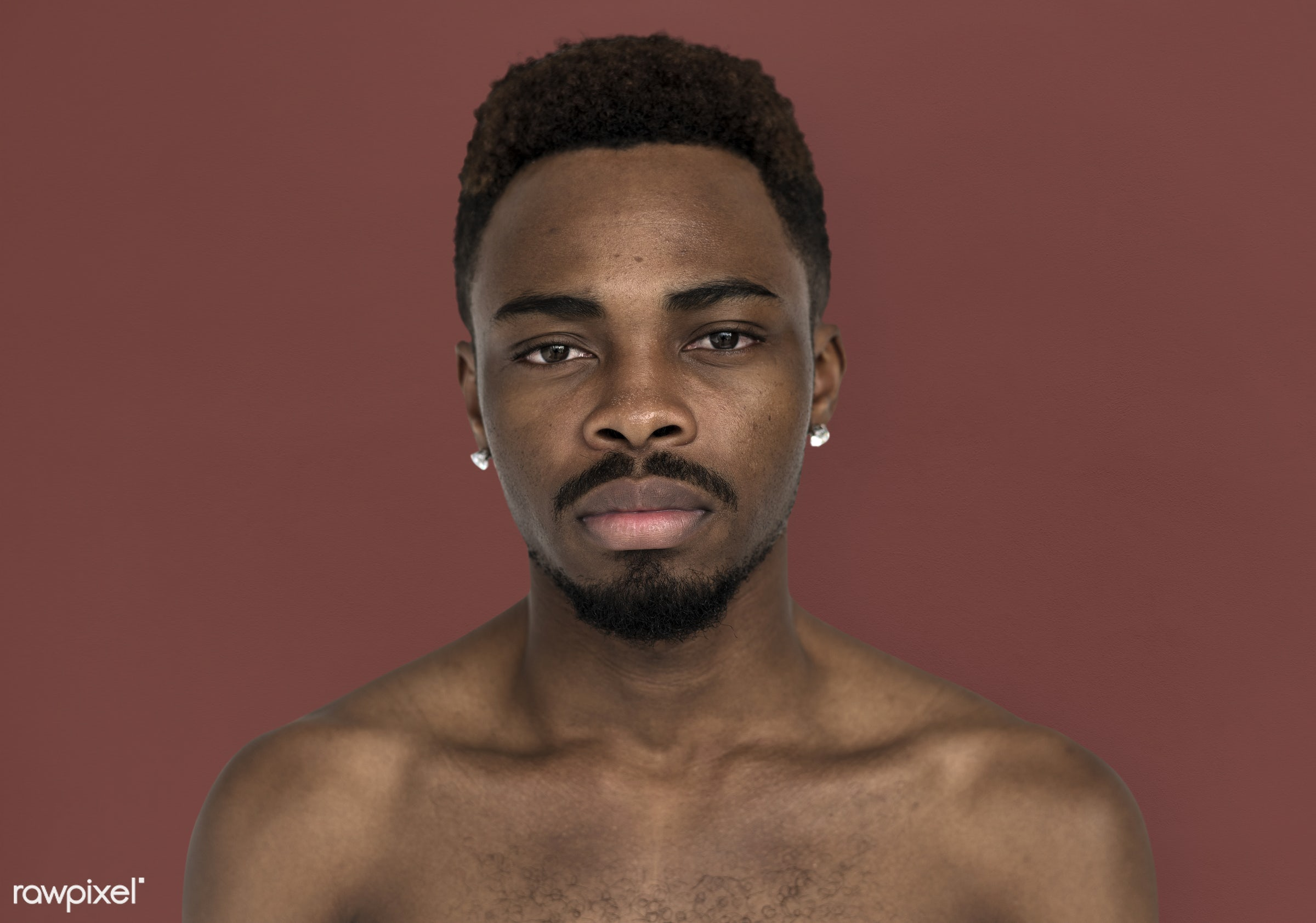 studio, face, person, people, bare chest, solo, cold, serious, man, black, earrings, isolated, topless, guy, african descent...