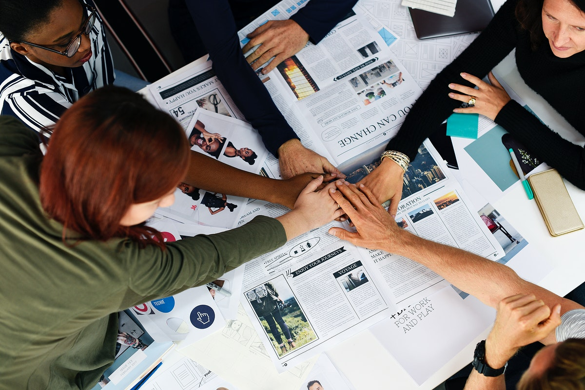 Diversity teamwork with joined hands