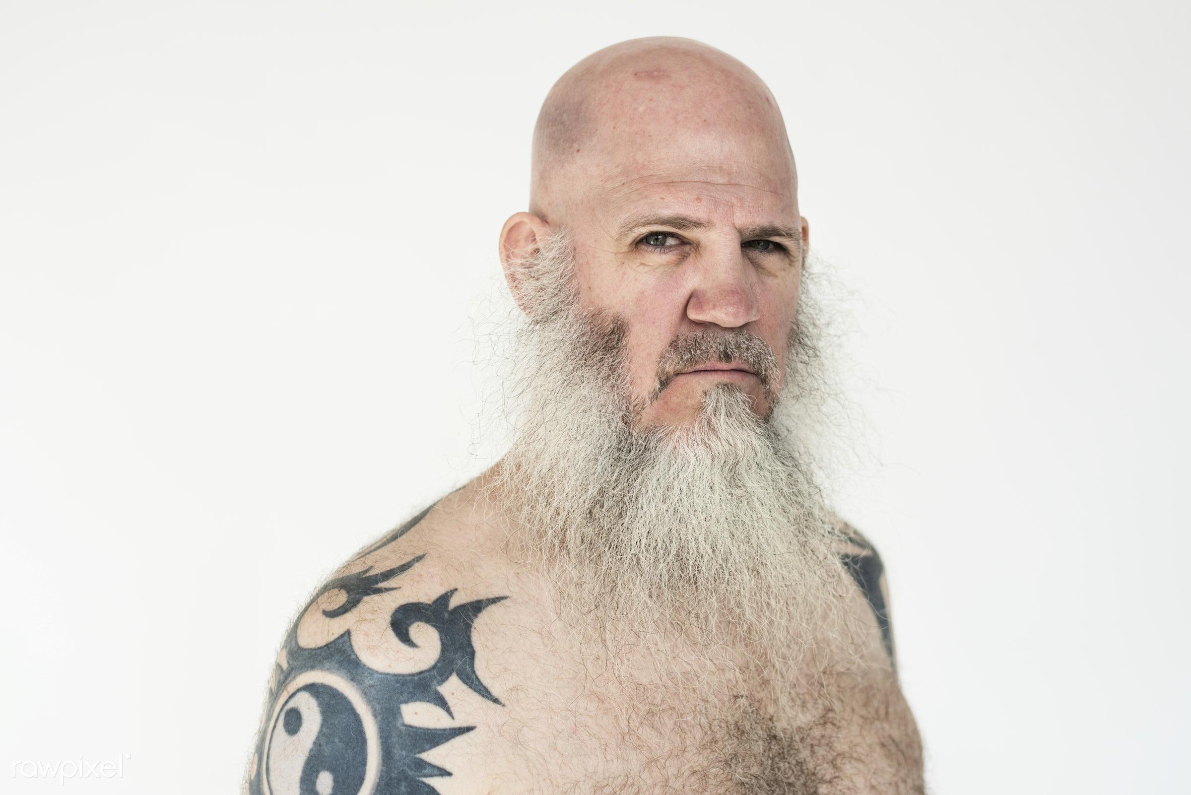 Portrait of a big tattooed bearded man - studio, body, person, concept, model, technician, people, skin, style, nature,...