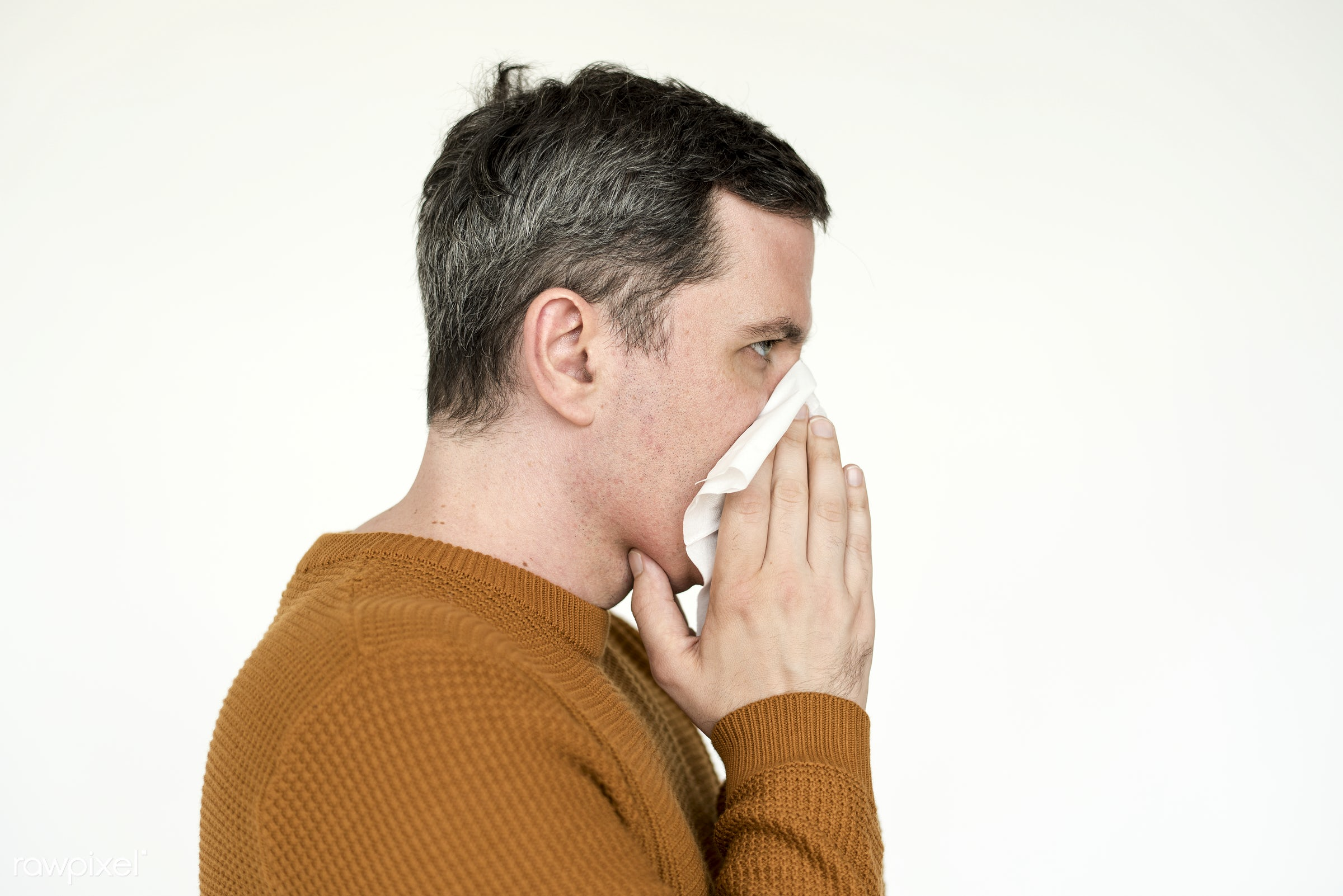 Portrait of a mature man sneezing into tissue - studio, concept, model, person, people, style, nature, stylish, men, closeup...