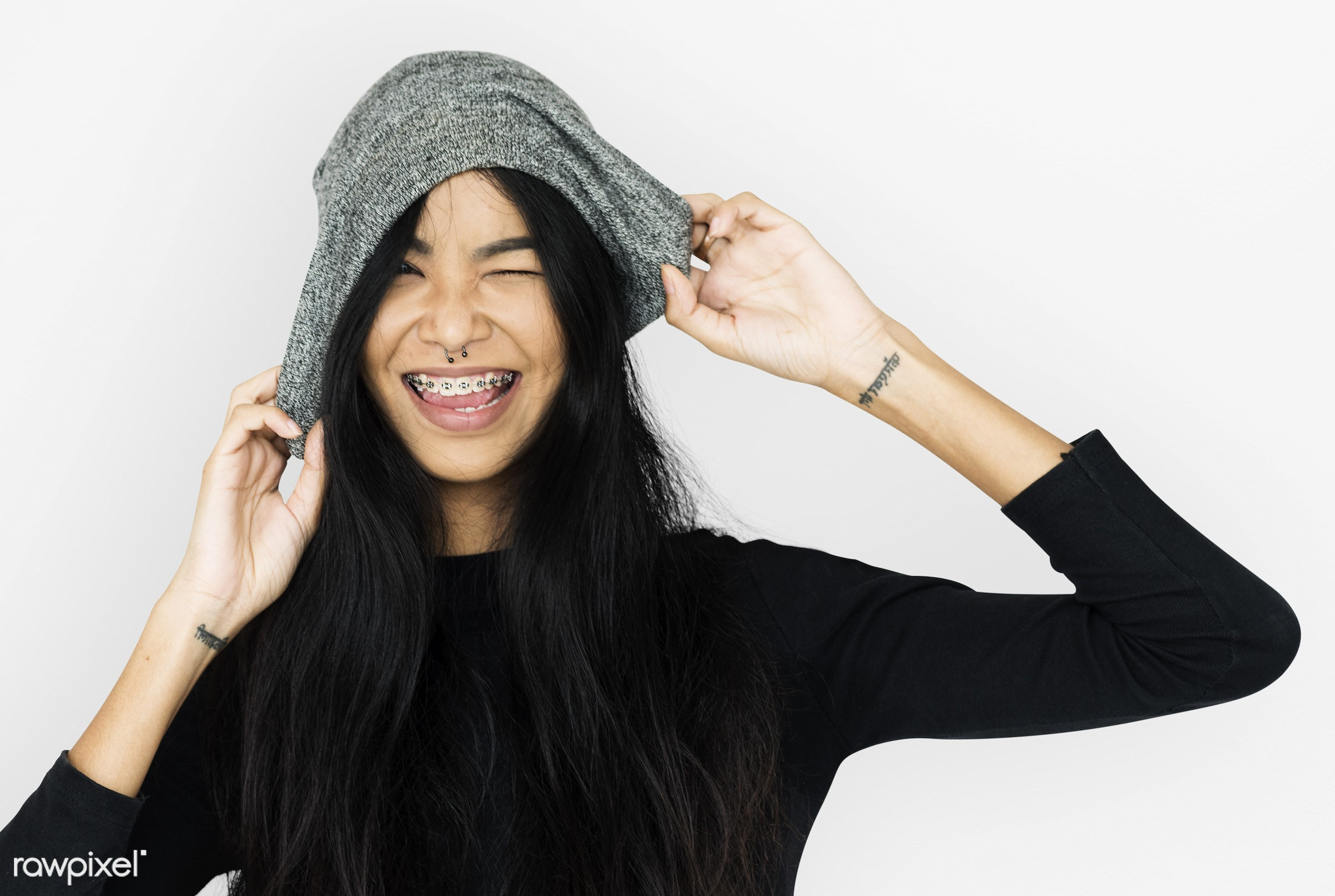 studio, festive, person, playful, lively, beanie, people, dental brace, solo, woman, happy, winking, alone, smiling,...