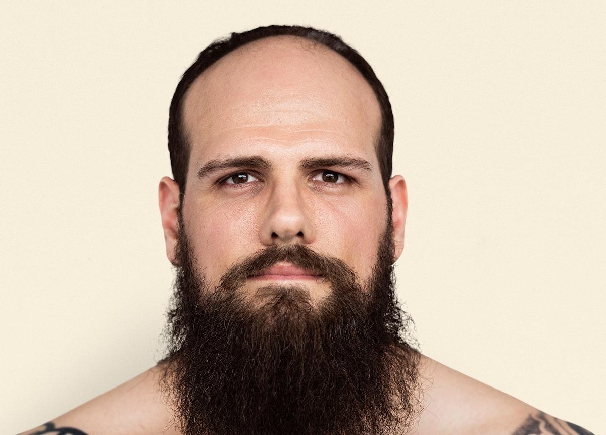 Caucasian Man Bare Chested Tattoo Beard