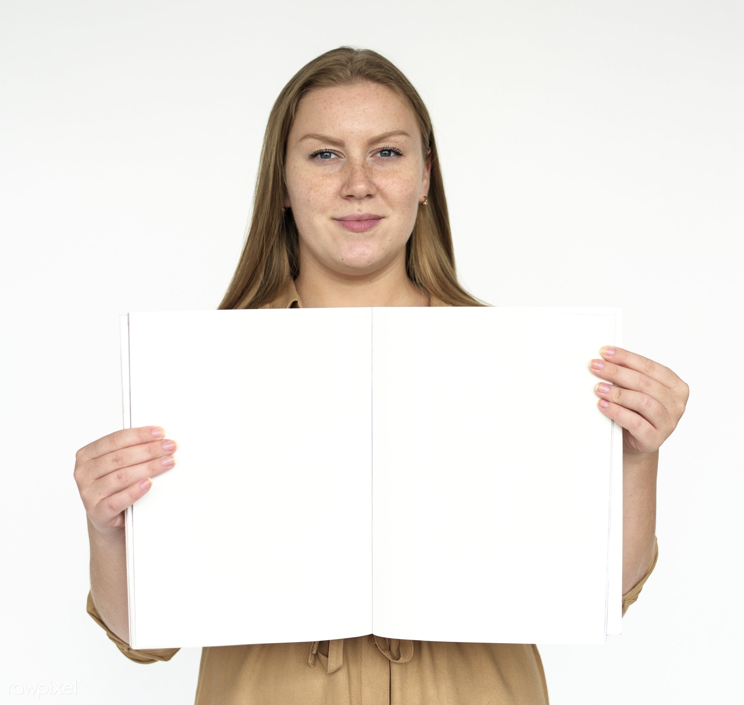 Woman holding a blank book - studio, expression, person, model, copyspace, isolated on white, race, people, placard, style,...