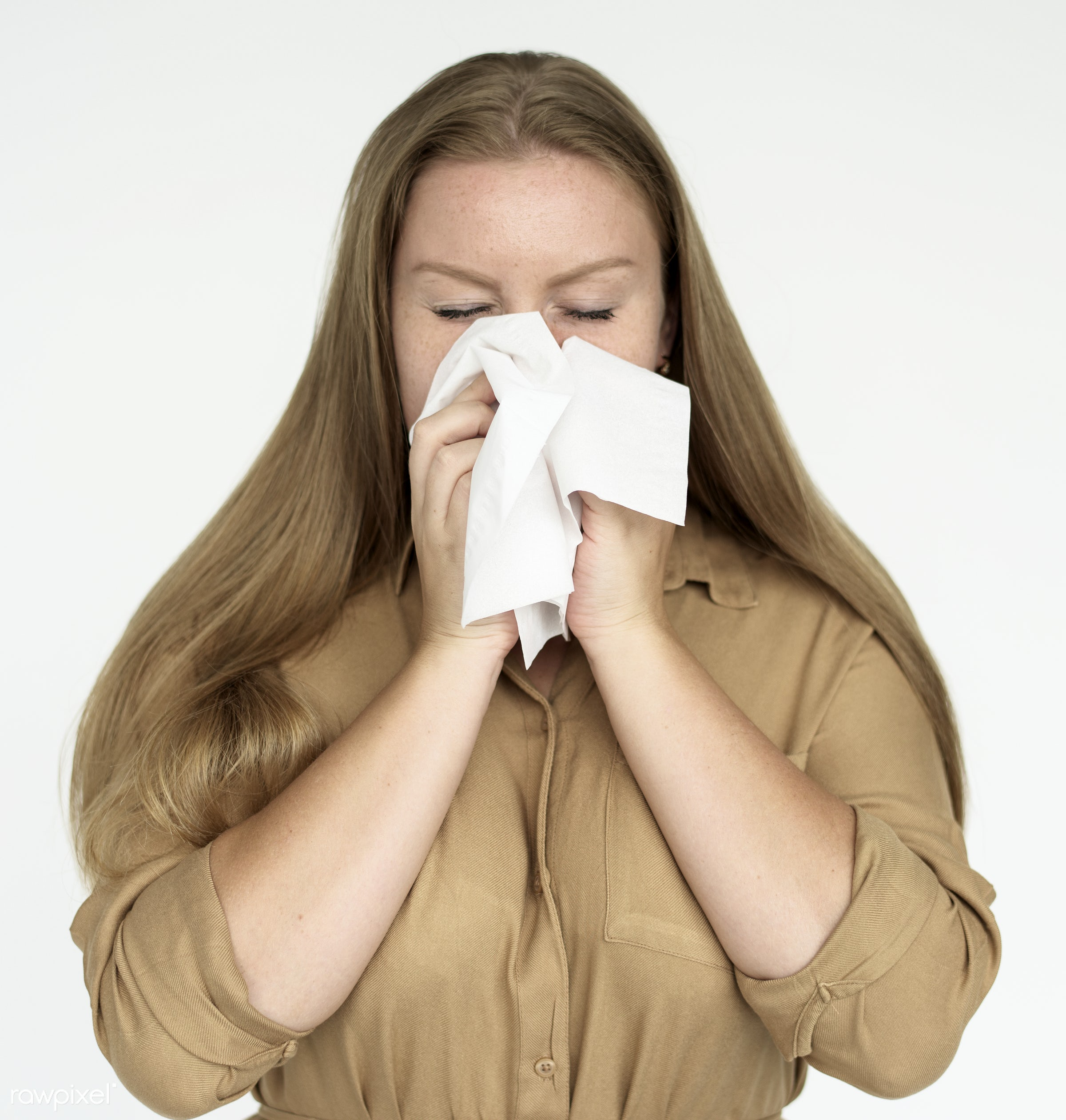Woman sneezing into tissue - studio, expression, person, model, isolated on white, race, people, style, woman, illness,...
