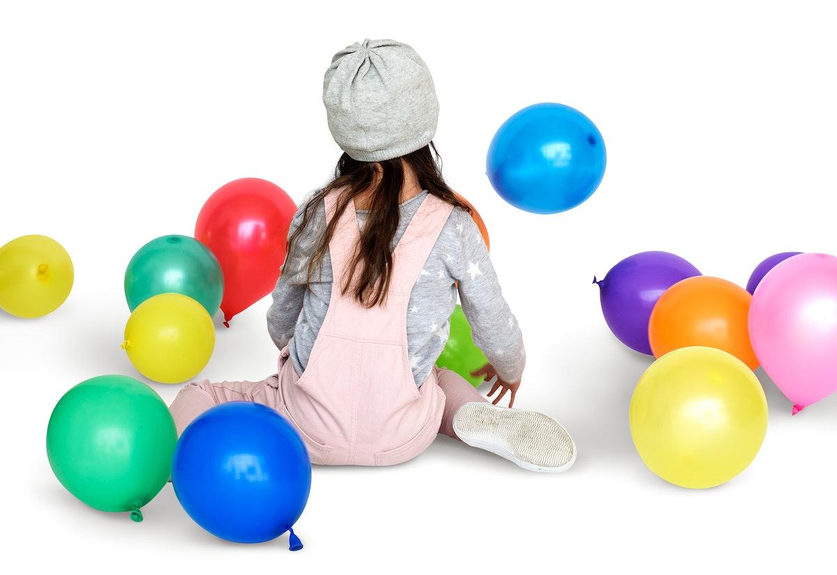 Little Girl Sitting Playing Balloon Portrait