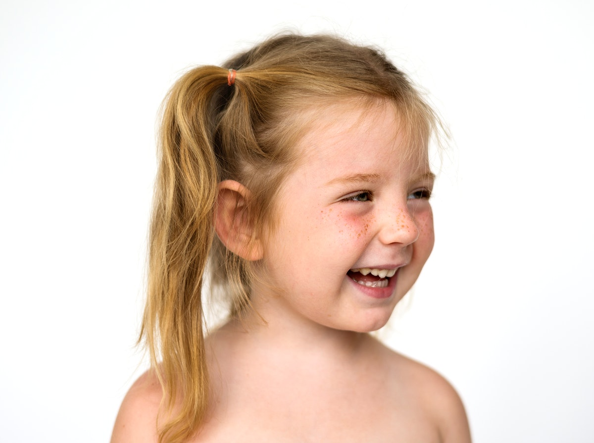 Young girl smiling face expression studio portrait