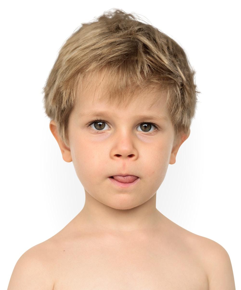Little Boy Bare Chest Sticking Out Tongue Studio Portrait