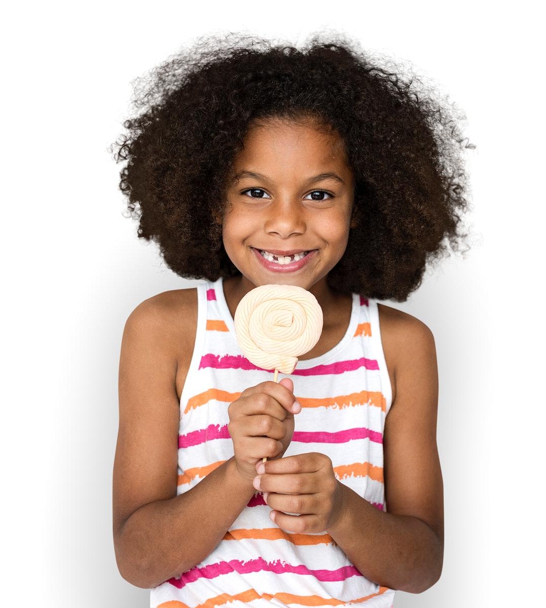 Little Girl Eating Lollipop Smiling