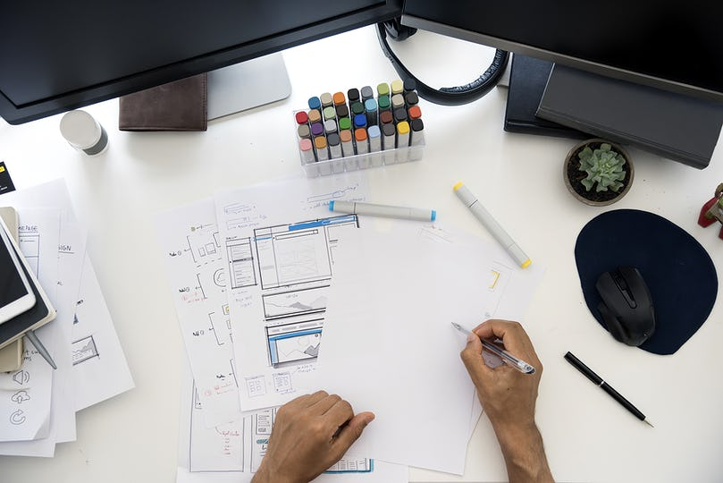 Man Working Planning Documents Diagram White Table