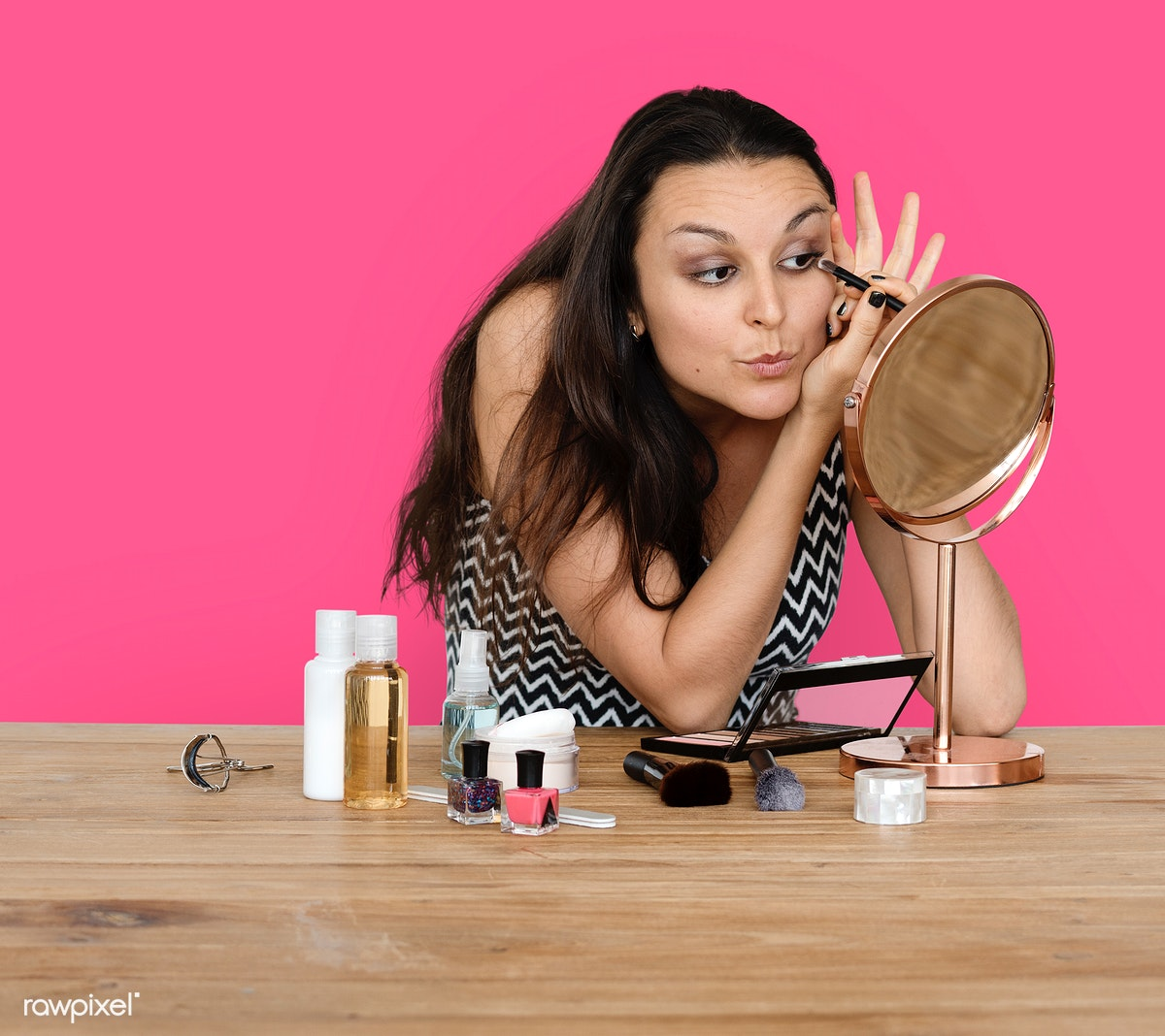 Download premium image of Woman making up her face with cosmetics 246011