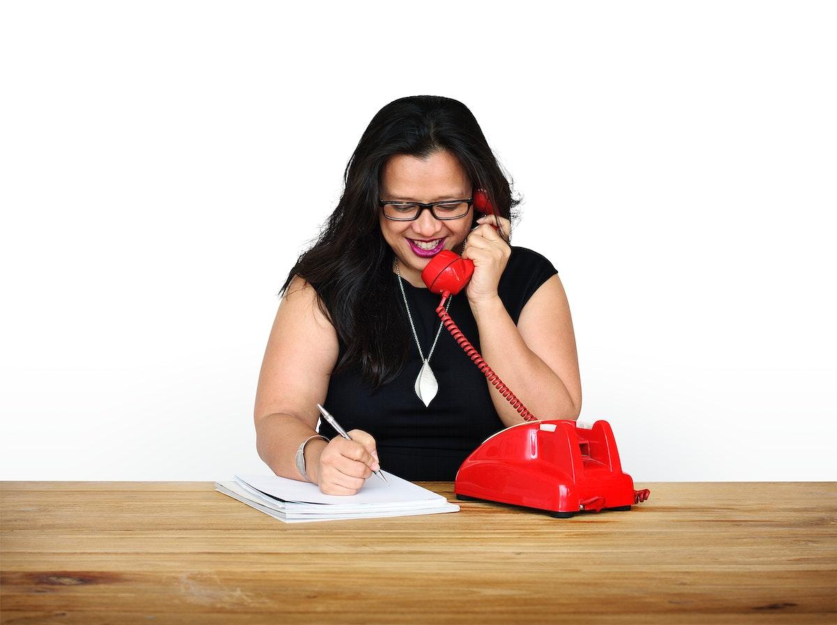 Woman Writing Talking Telephone Communication