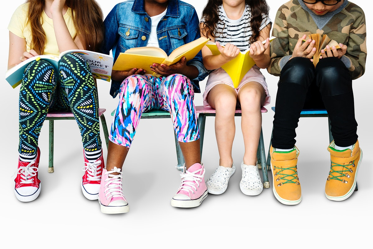Group of students sitting and reading book