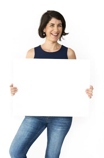 Happiness woman holding blank banner studio portrait