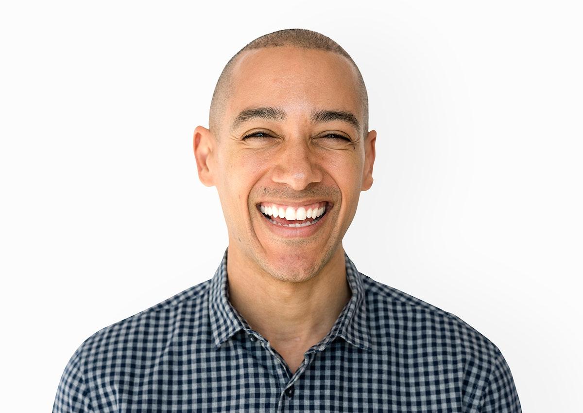 Skinhead man wearing checkered shirt studio shoot and smiling