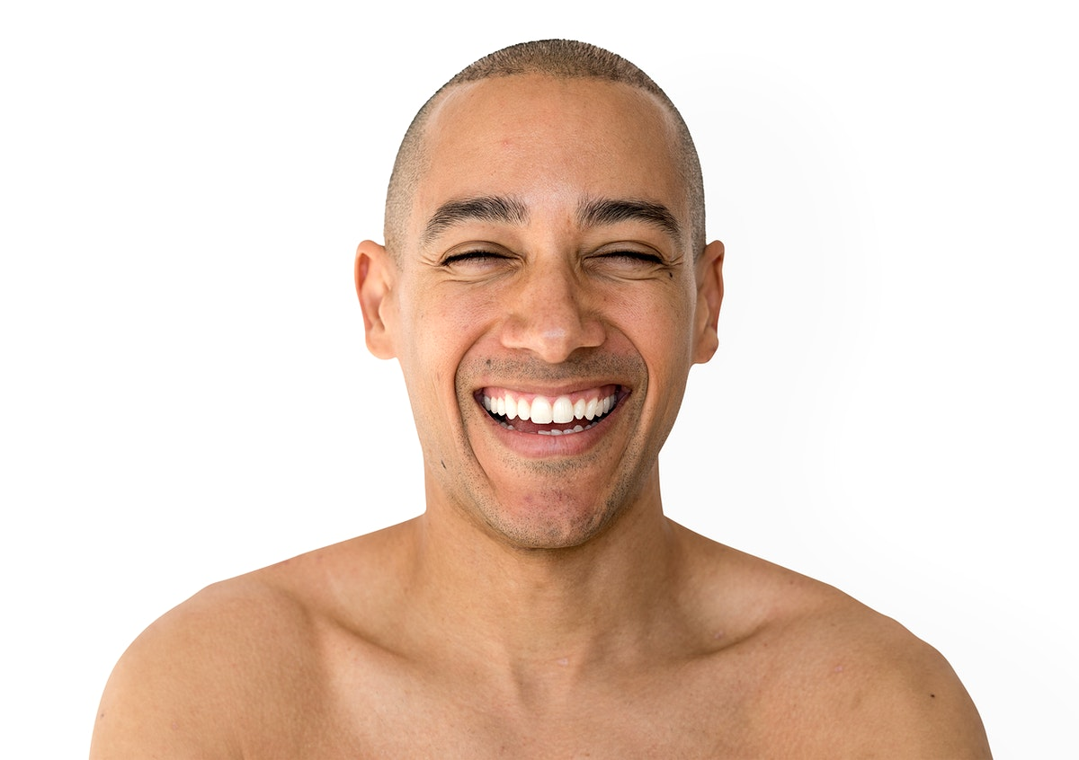 Skinhead man smiling with topless studio shoot