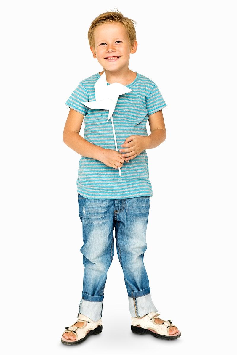Happiness little boy smiling and holding pinwheel studio portrait