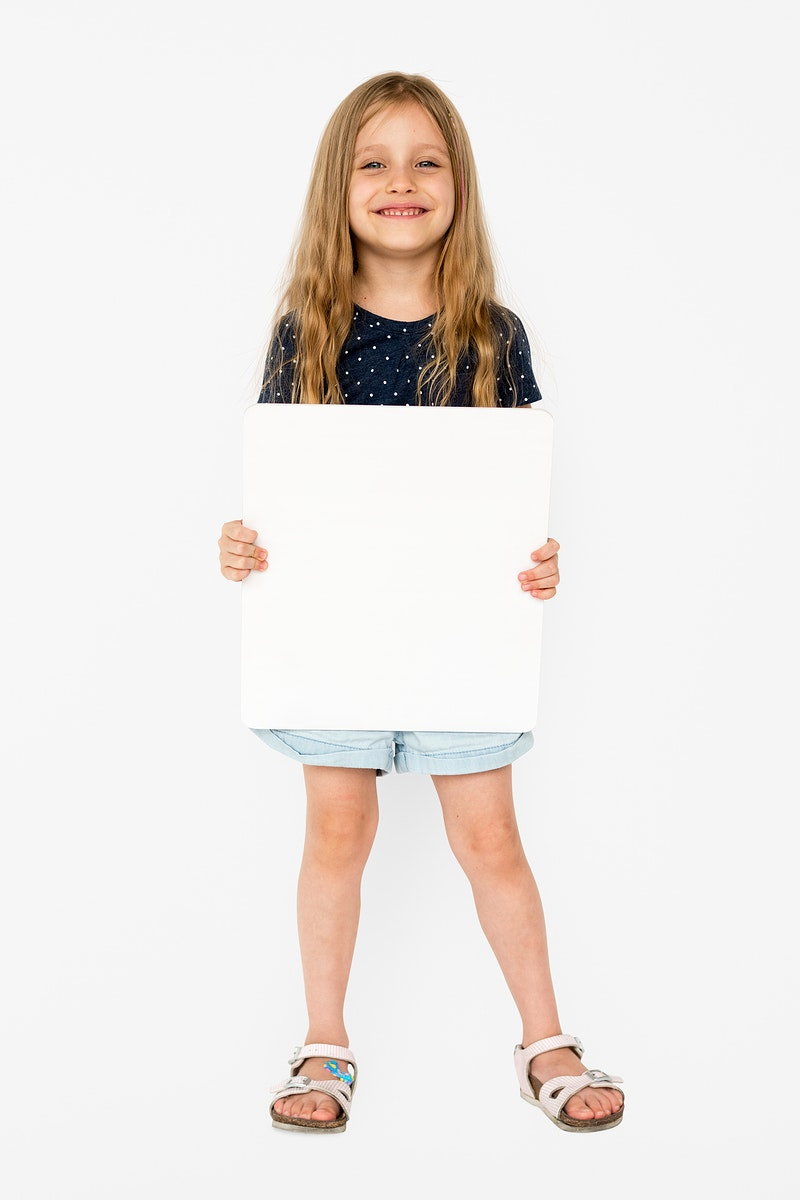 Little girl smiling and holding blank placard