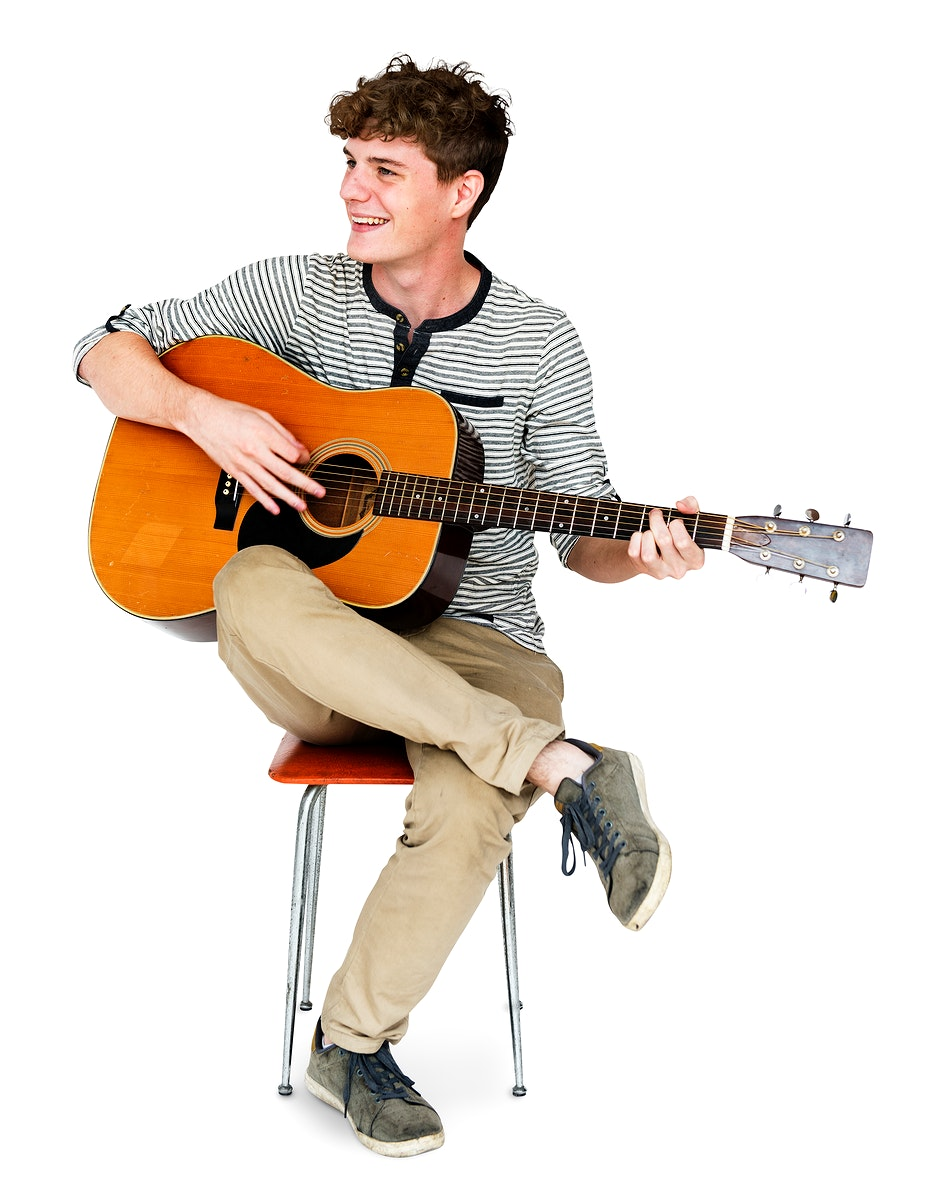 Young Adult Man Sitting Playing Guitar Studio Portrait
