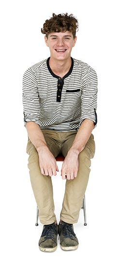 Young Adult Man Sitting with Smile Face Studio Portrait