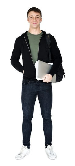 Young adult man smiling and holding laptop