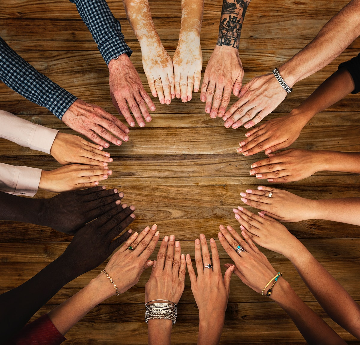 Group of hands assemble in aerial view