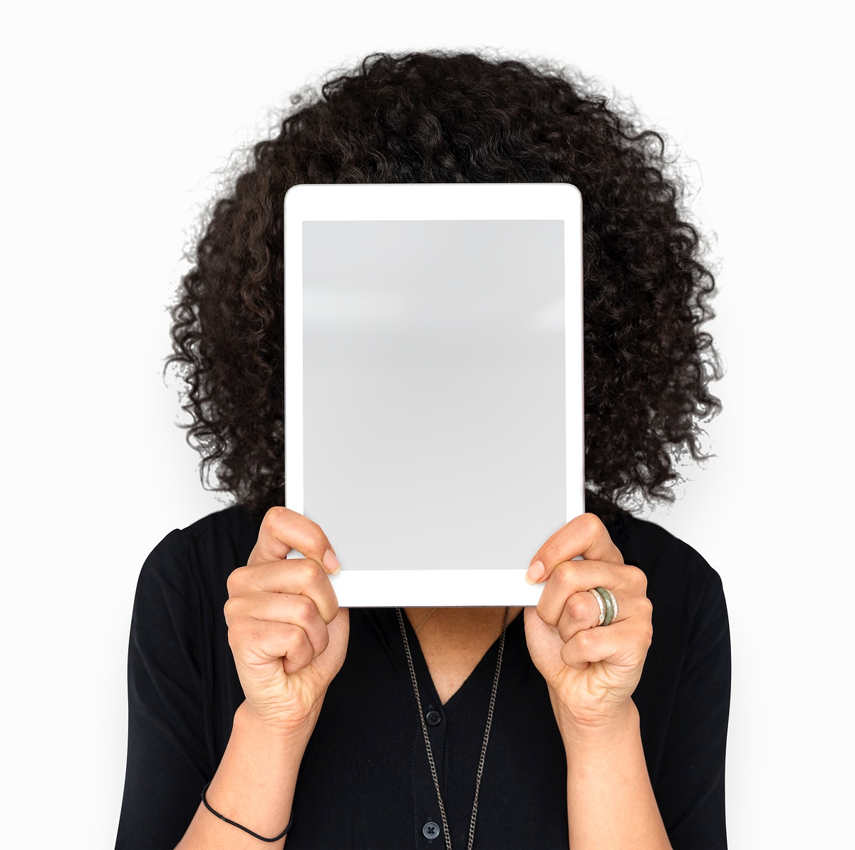 Woman holding tablet covering her face