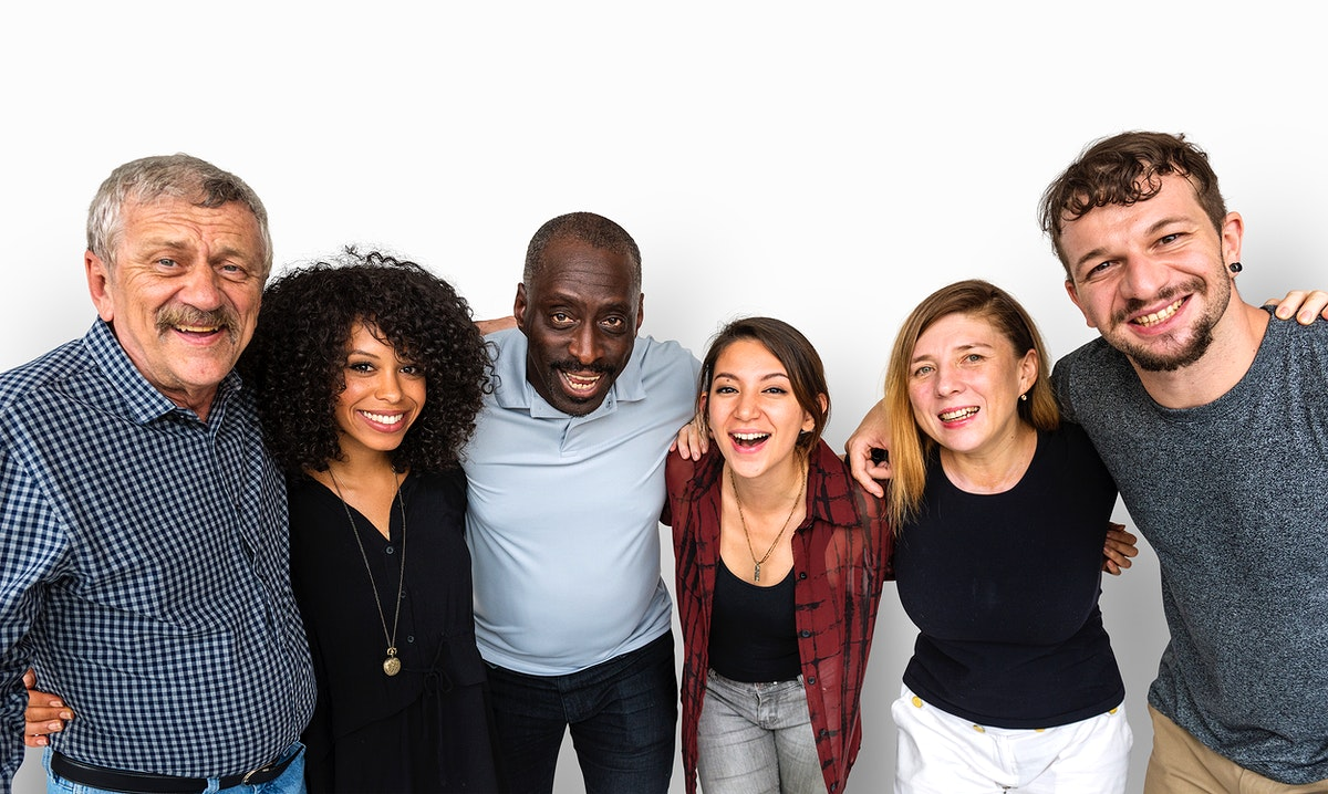 Group of deversity people arms around support together