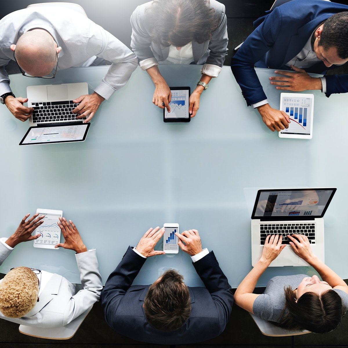 Group of diverse business people are using digital devices