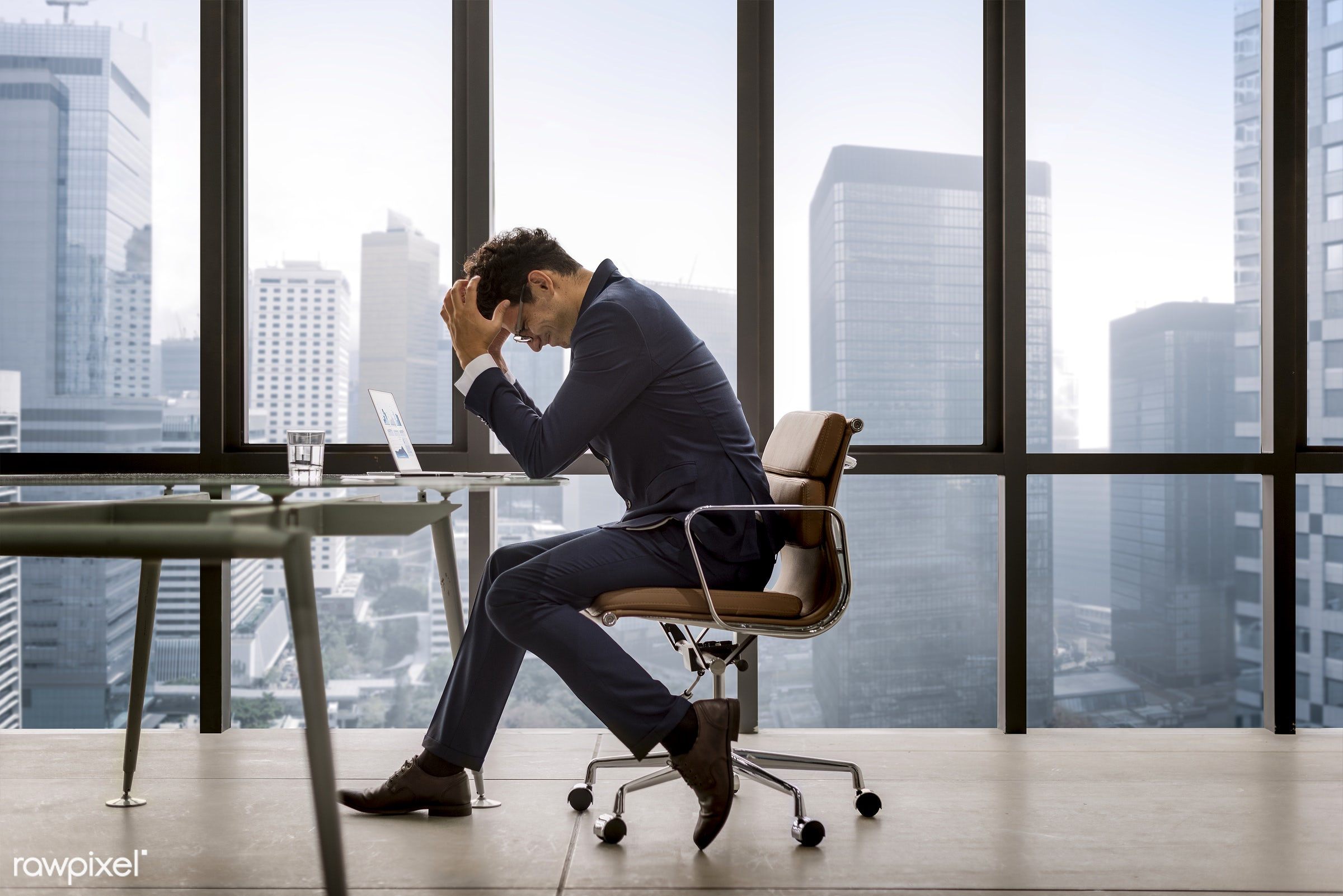 Stressed young businessman overworking - stress, tax, mistake, tired, problem, business, worried, headache, frustration,...