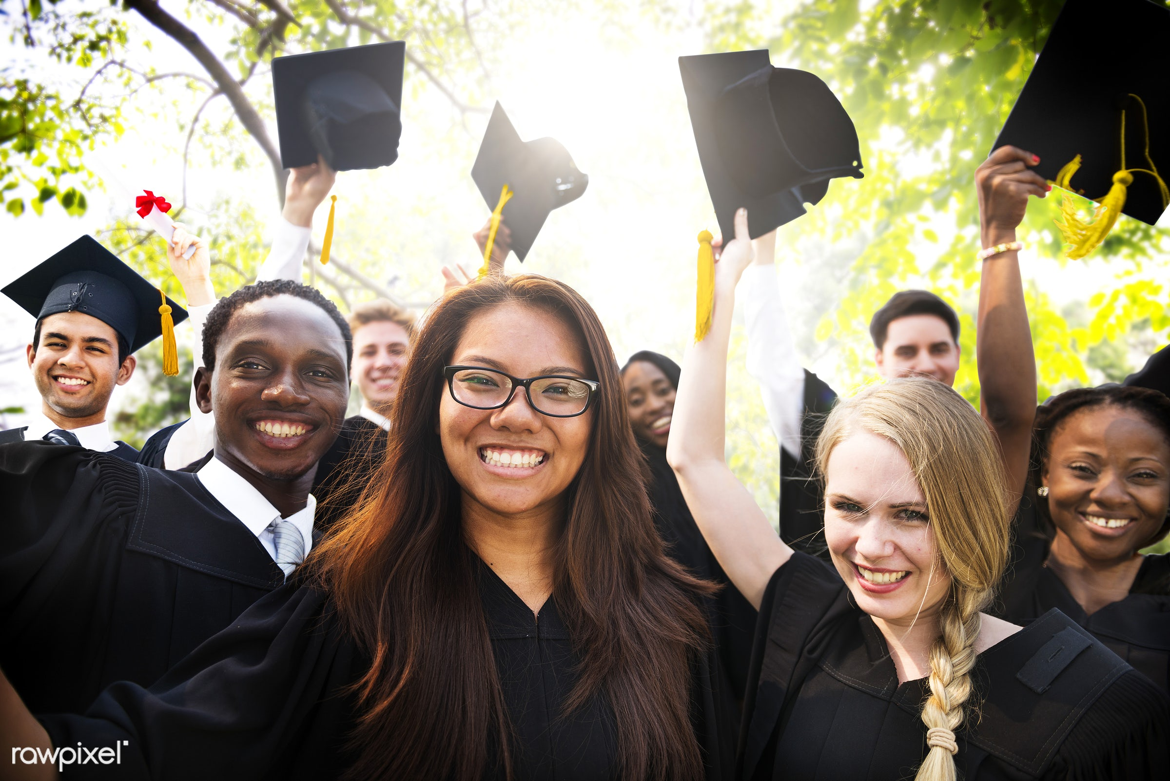 Group of diverse graduating students - graduation, success, university, achievement, african descent, asian ethnicity, cap,...