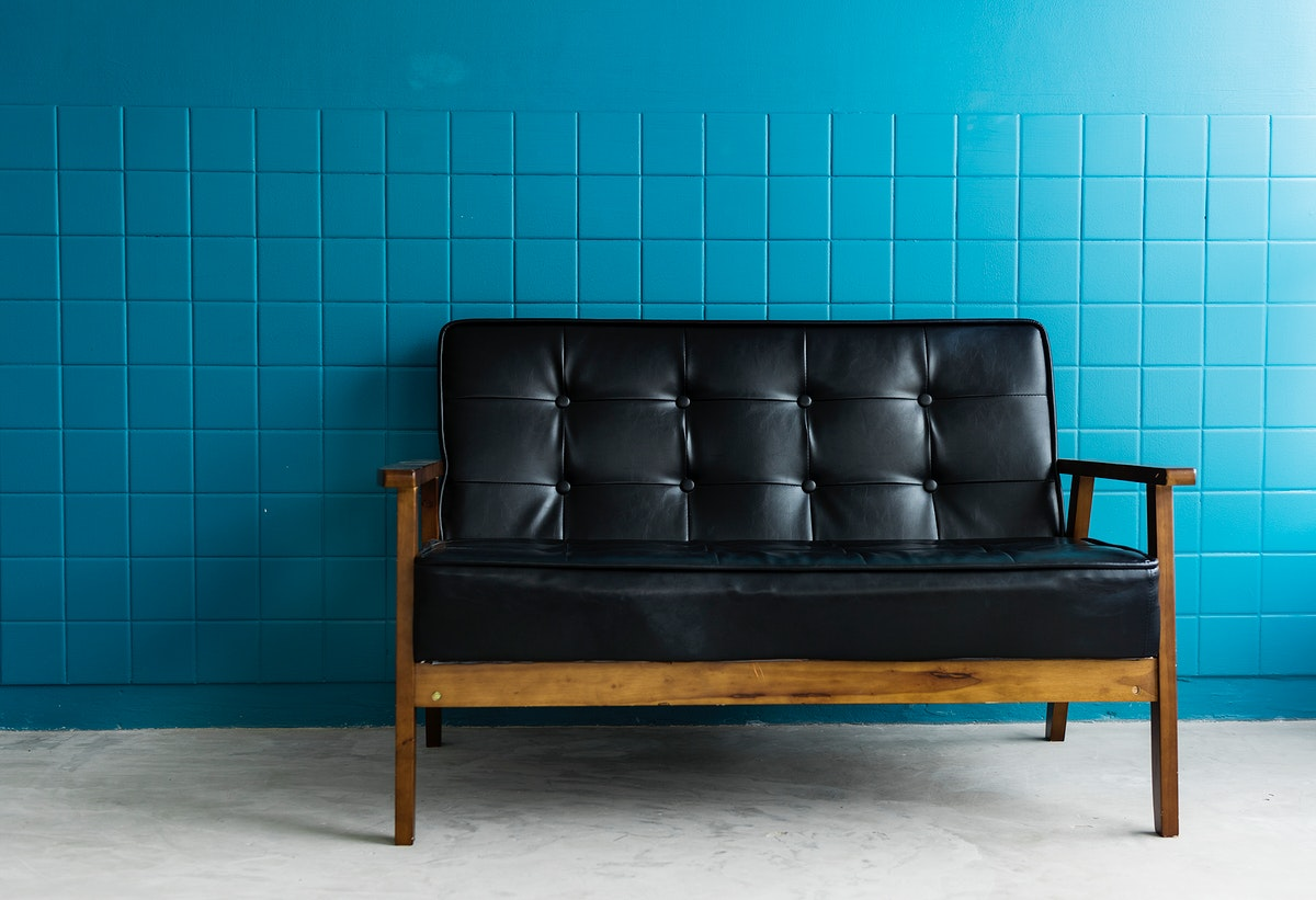 A Black Couch in a Bright Living Room