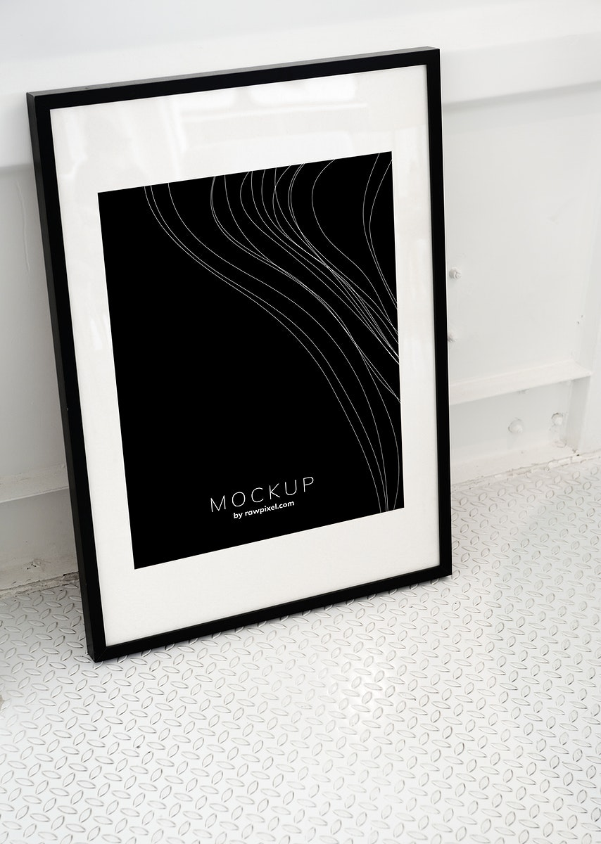 Black picture frame mockup on the floor