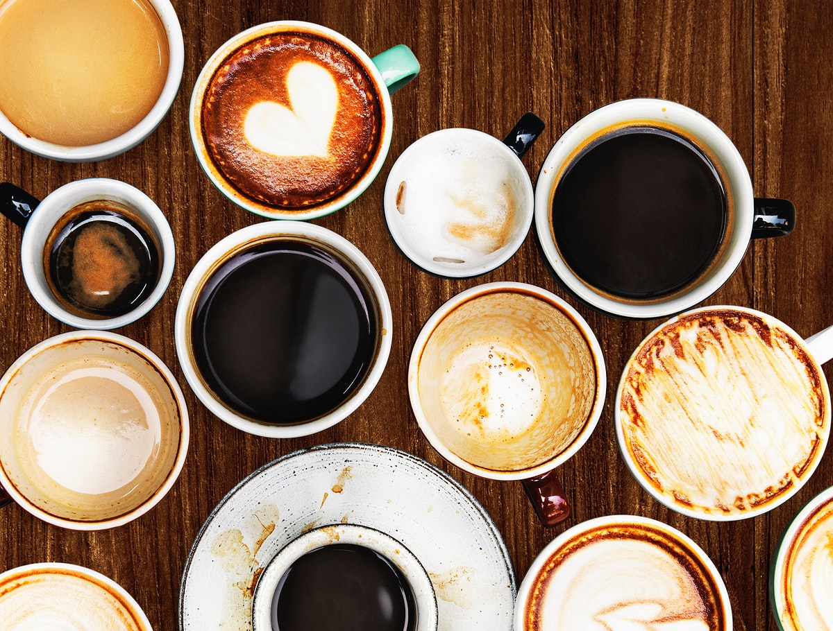 Assorted coffee cups on a wooden table