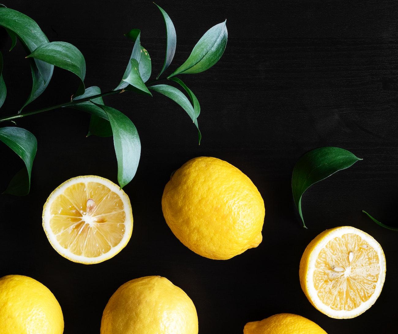 Fresh yellow lemons on black background | Royalty free photo - 400605